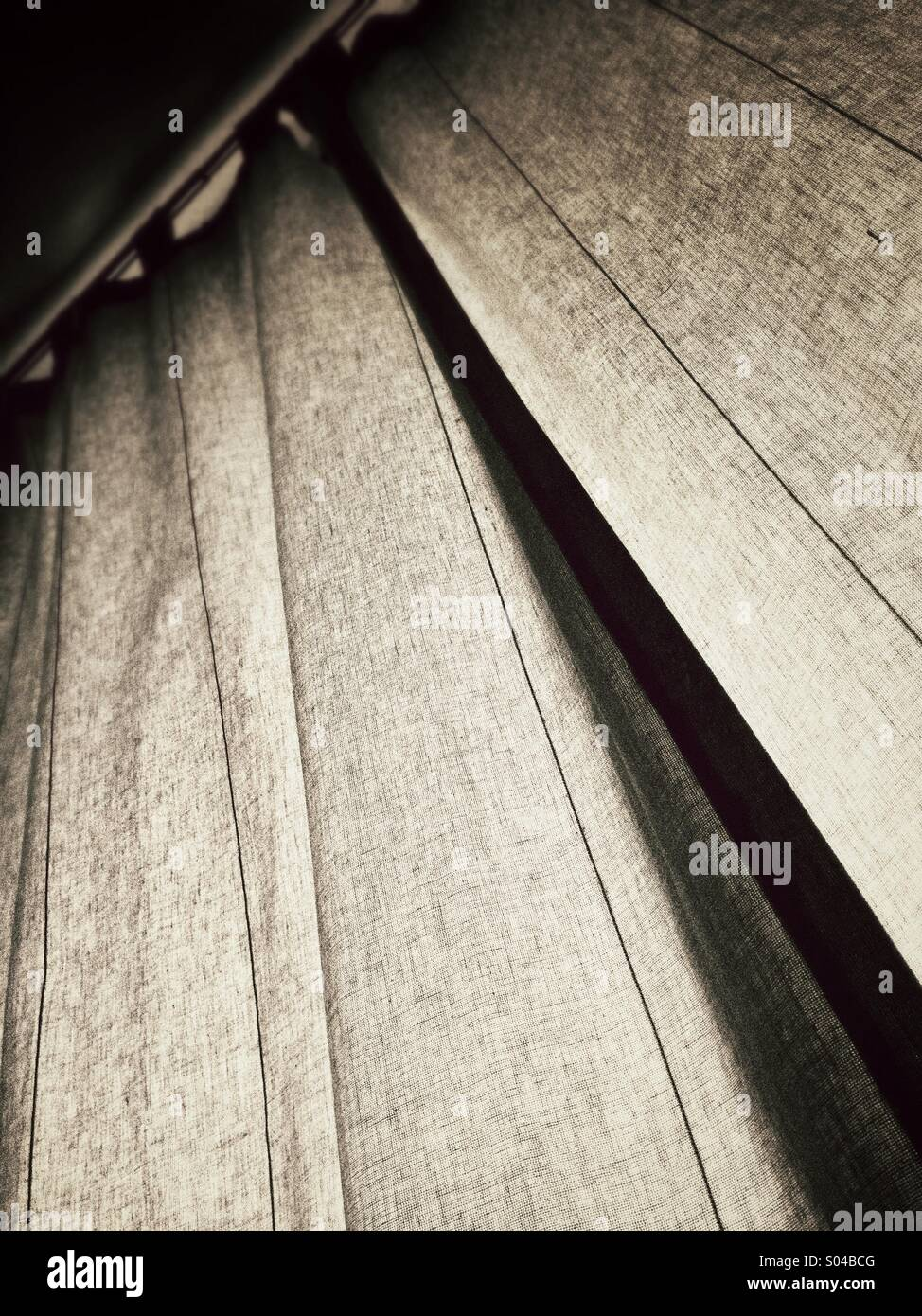 Curtains with tie backs - Stock Image