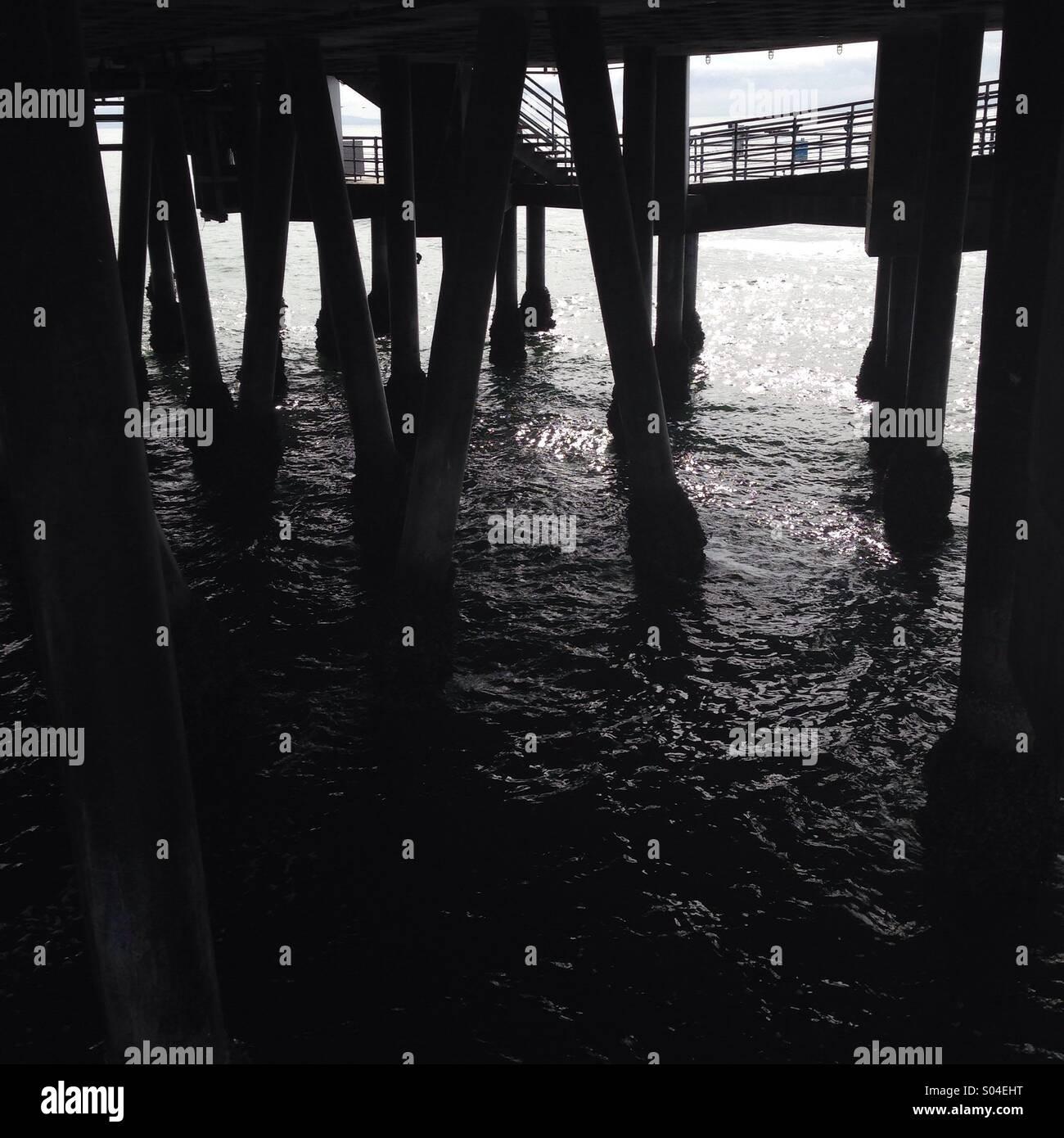 Below the pier. - Stock Image