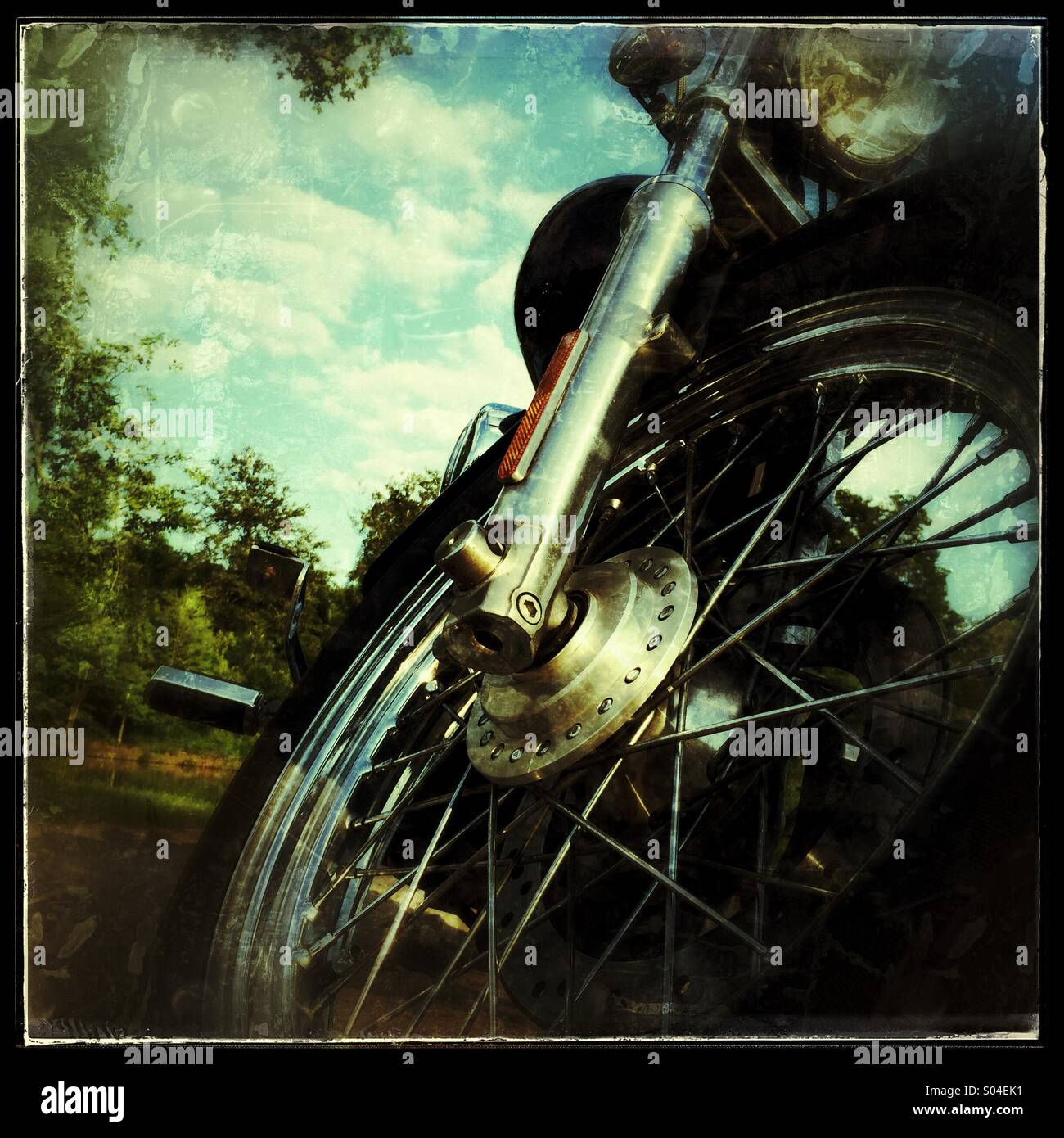 Front end of retro motorcycle grunge image - Stock Image