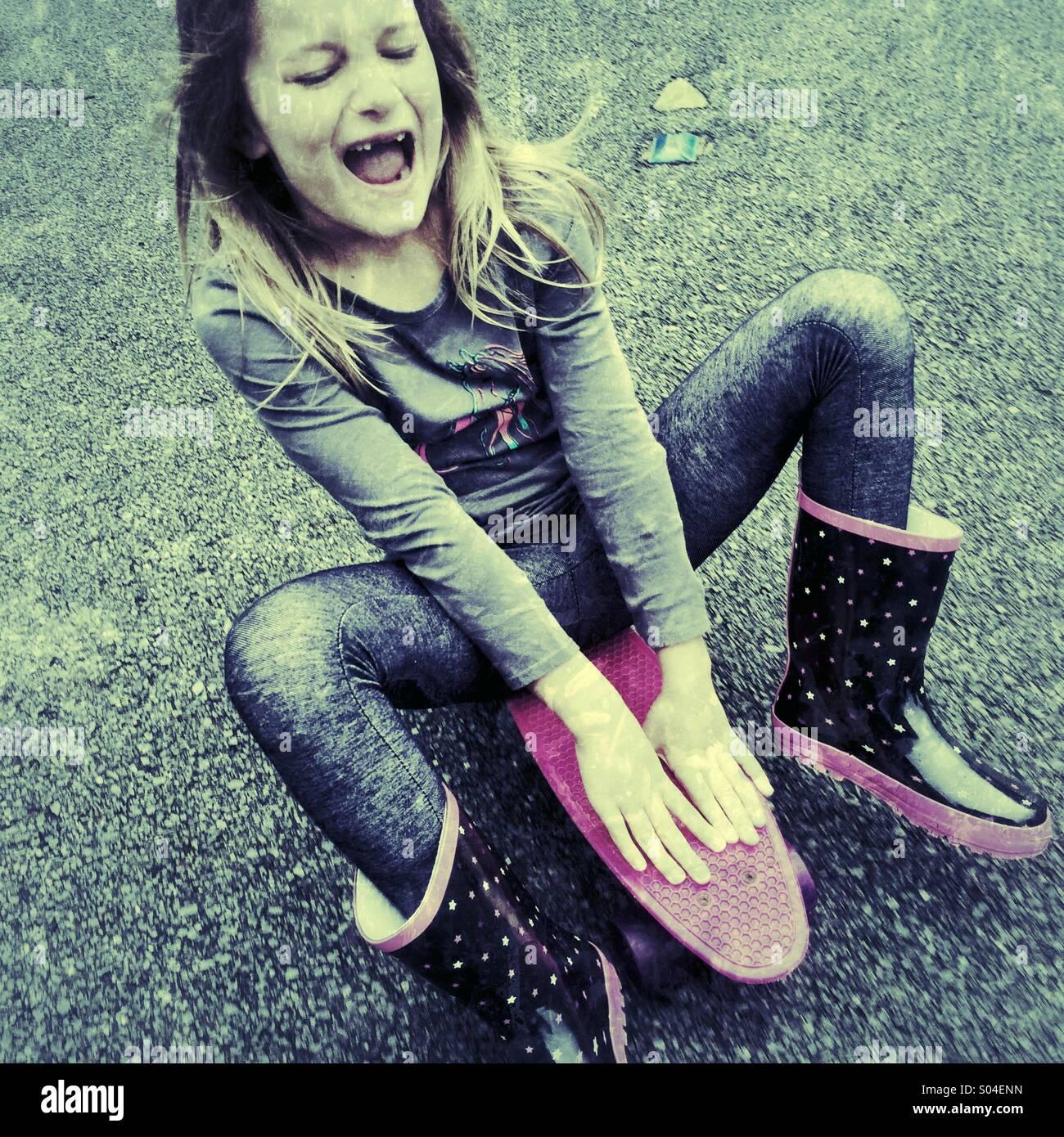 Girl with skateboard - Stock Image