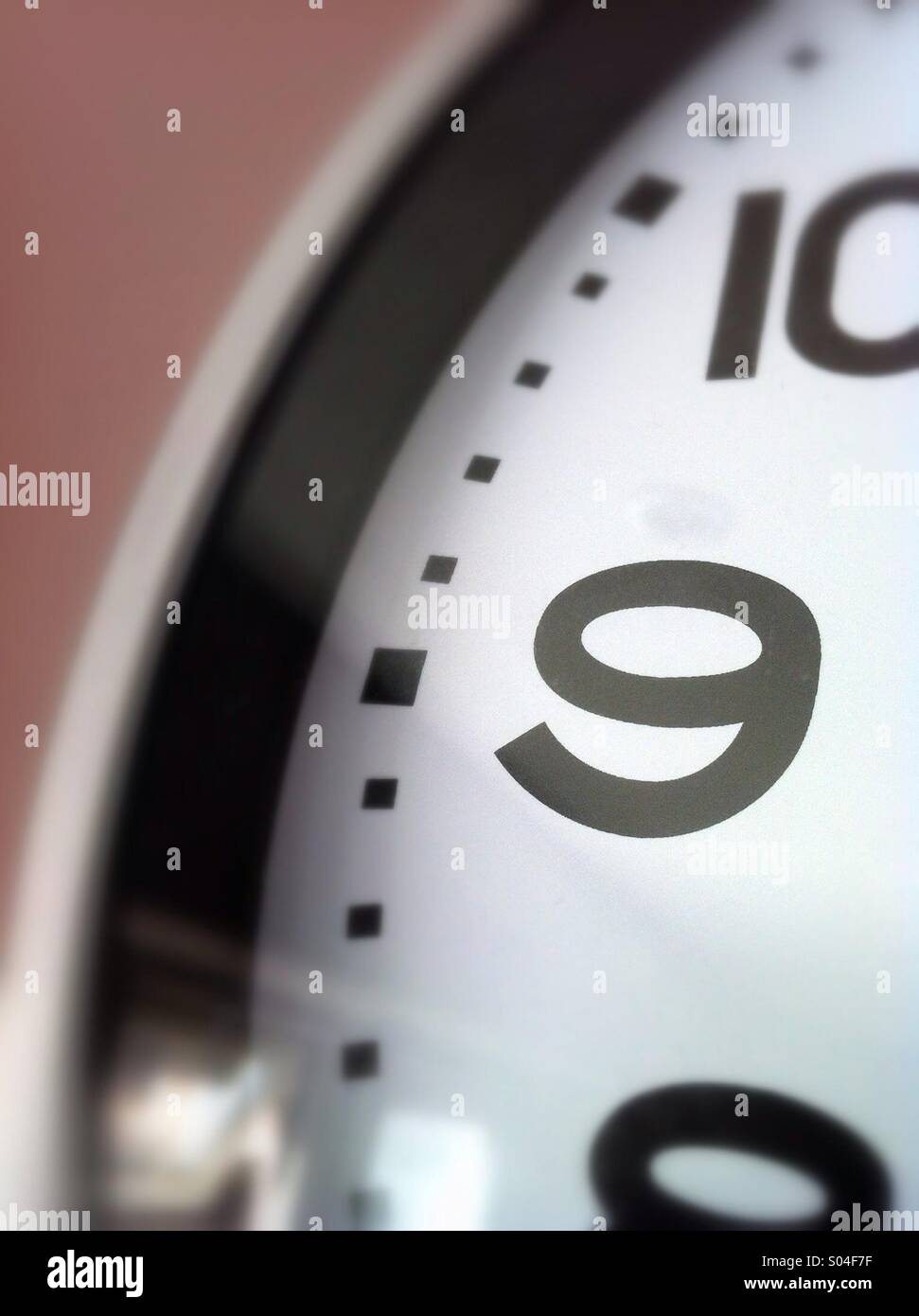 Number 9 on clock face - Stock Image