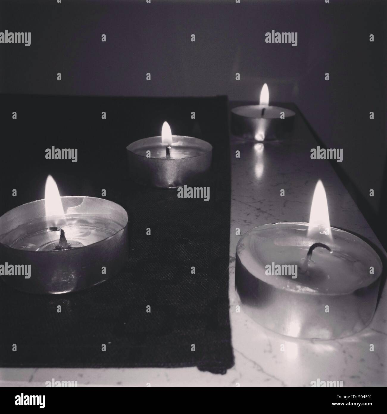 Candles in the dark - Stock Image