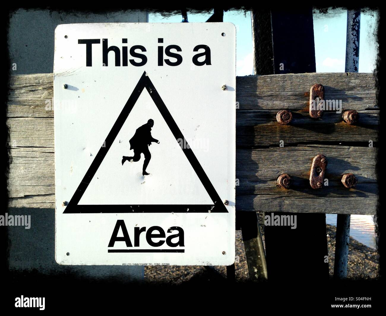 Anti- theft warning sign at the seaside. - Stock Image