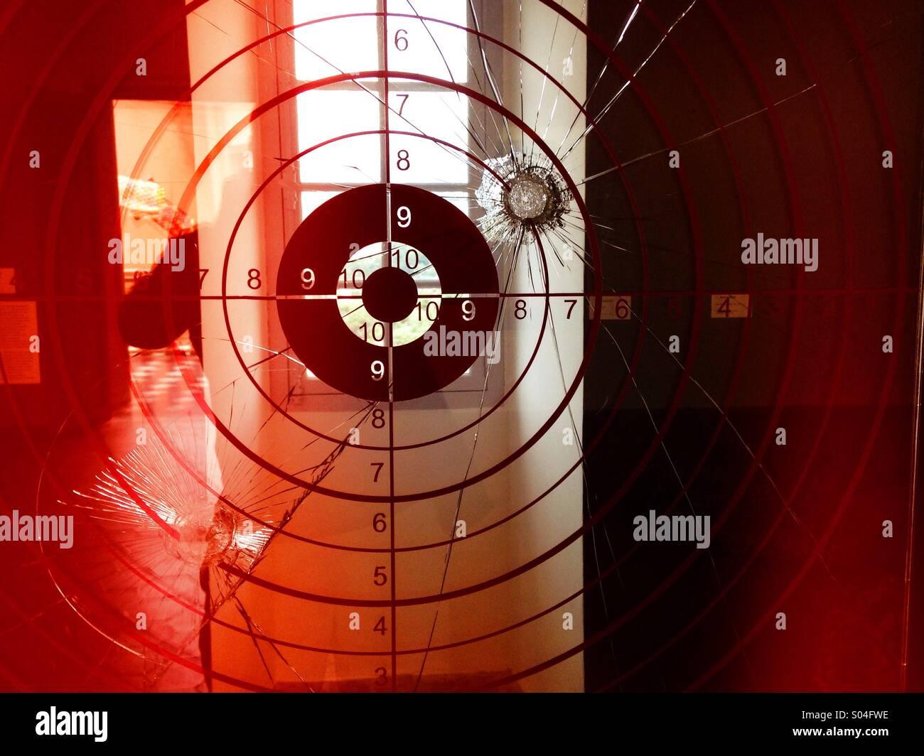 Bullseye and bullet hole - Stock Image
