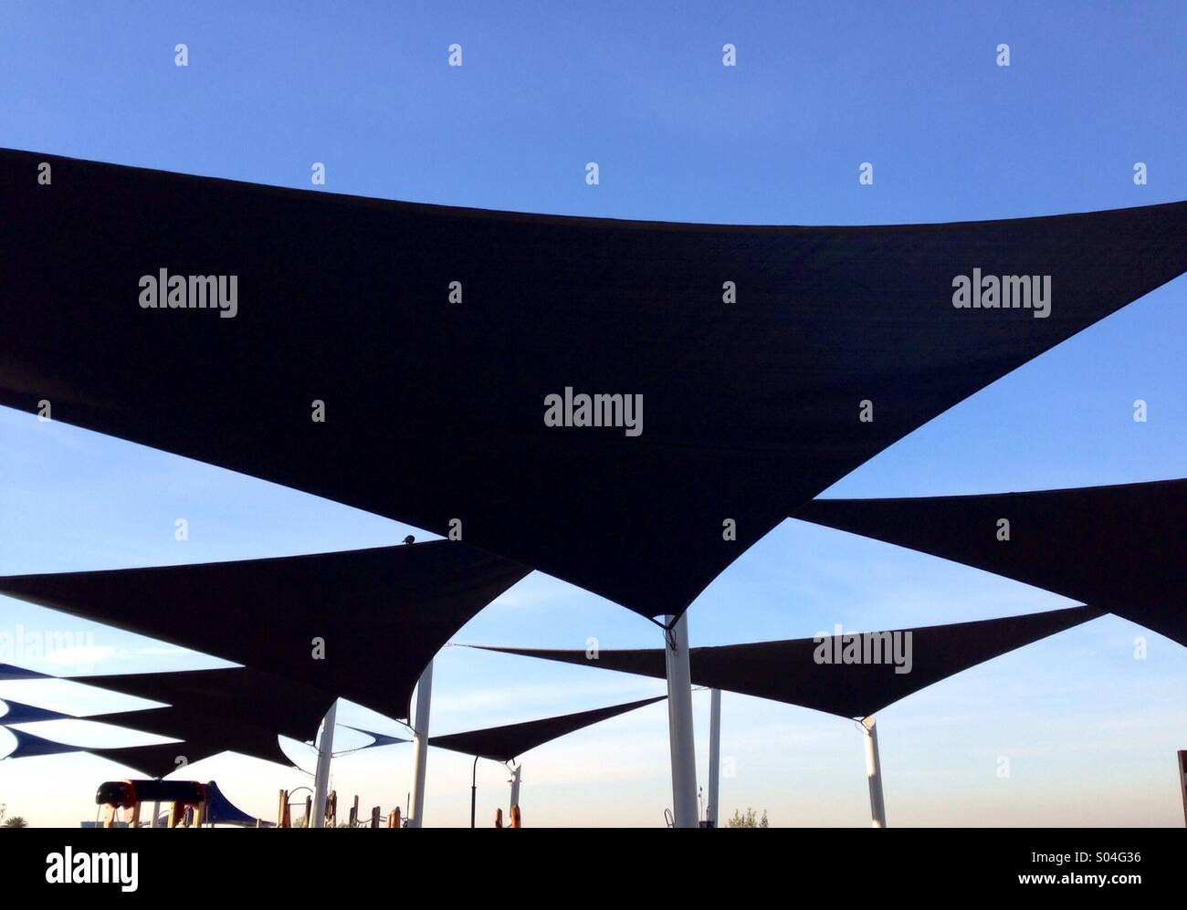 Shade sails by the sea - Stock Image