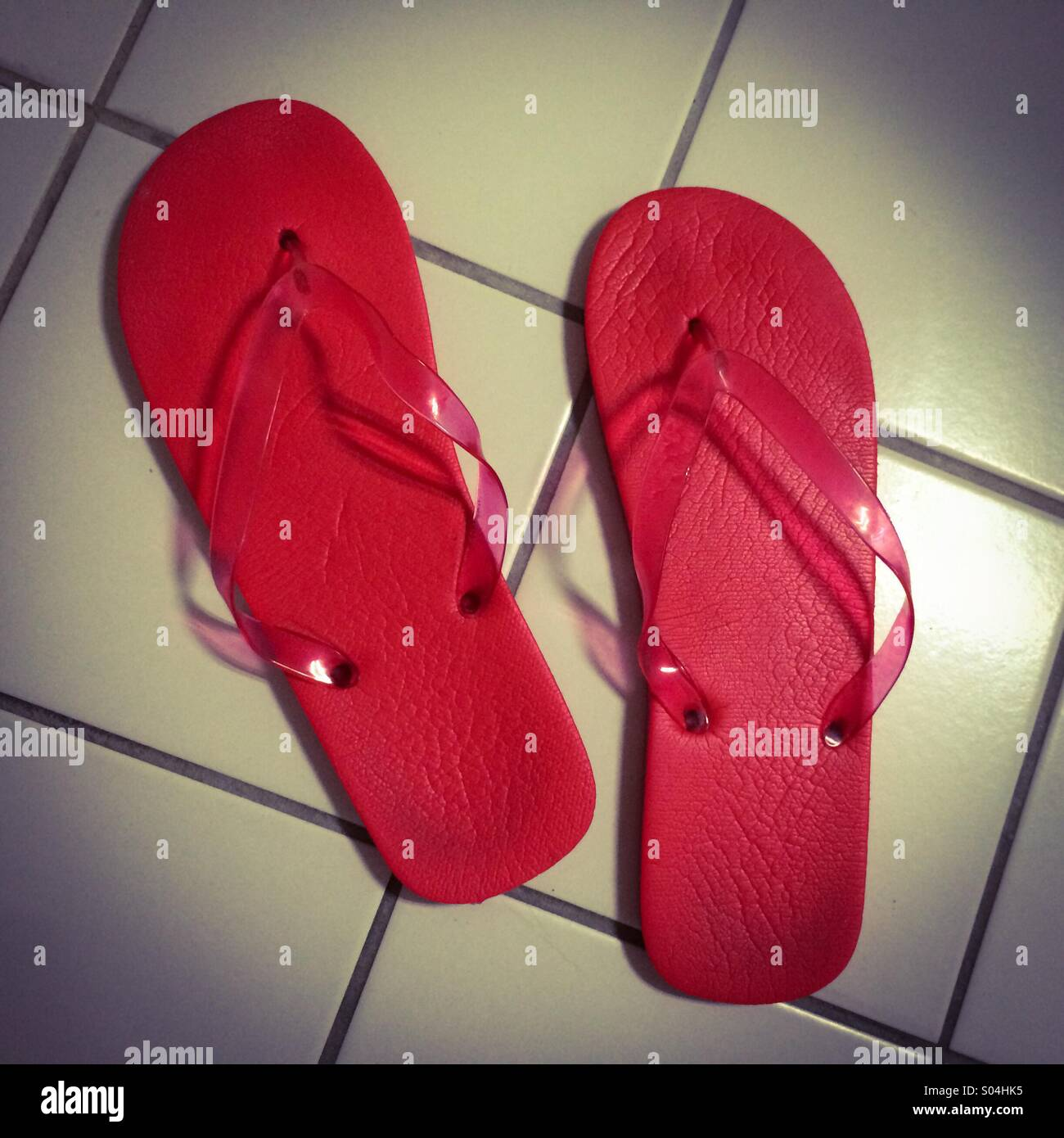 1f740bd93de Red slippers on white tiles Stock Photo  309888297 - Alamy