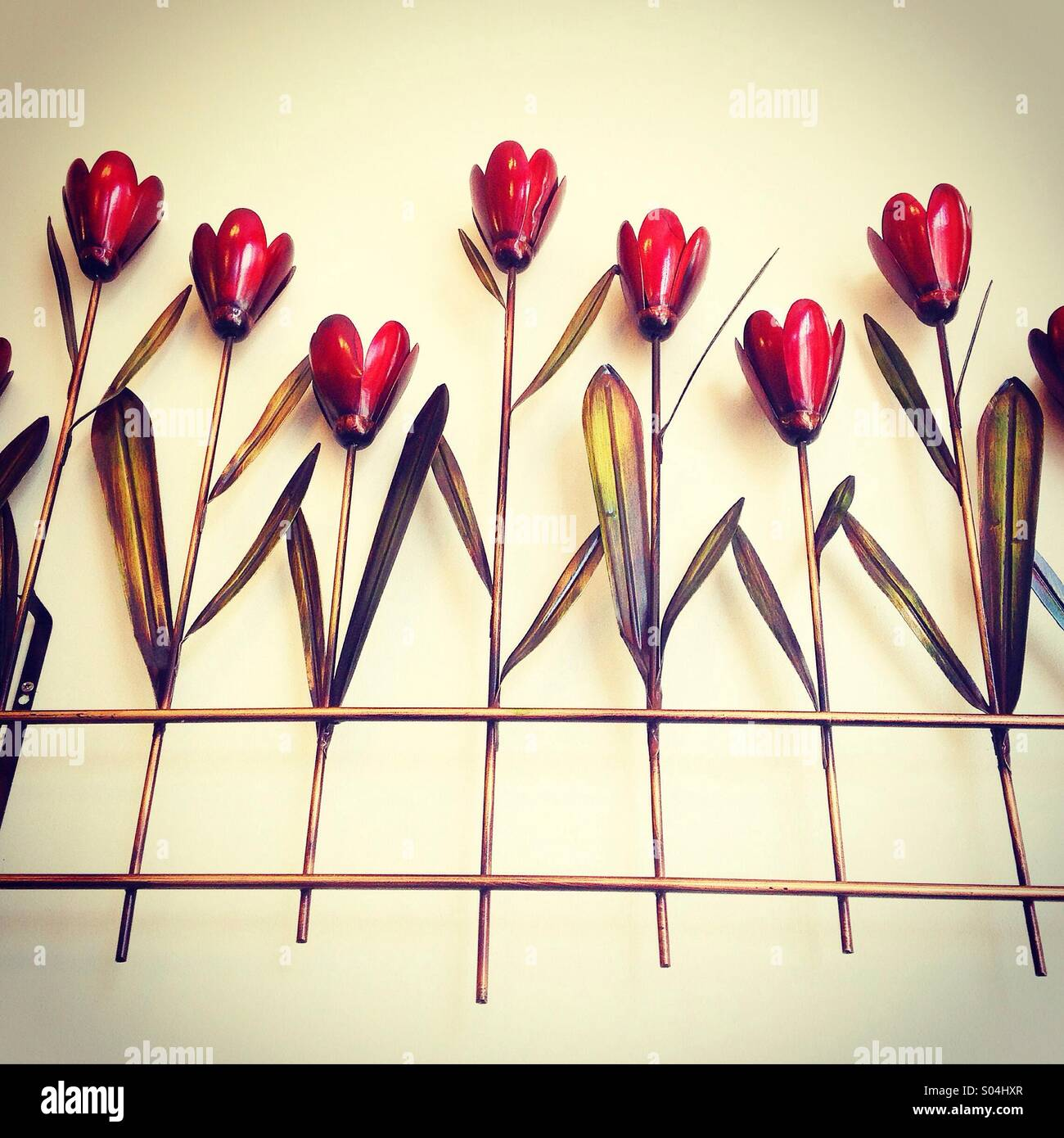 A metal wall hanging in a tulip design - Stock Image