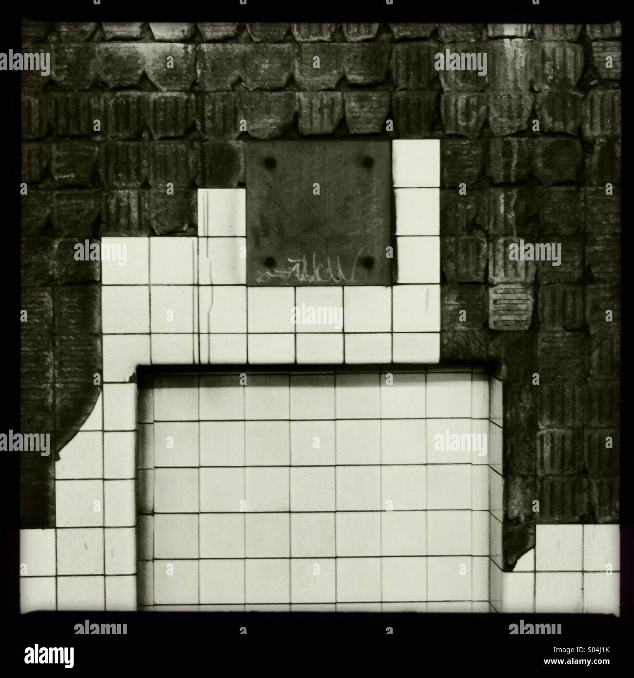 Subway. Wall of the tunnel at the 21st station of the G line in Queens, NY. Tiles are falling off leaving interesting - Stock Image