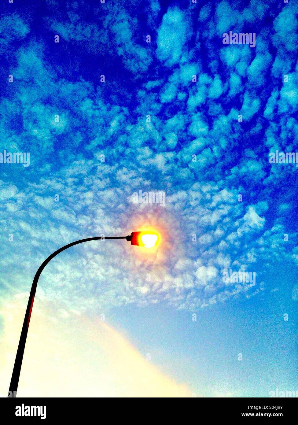 Lamppost in front of cloudy sky - Stock Image