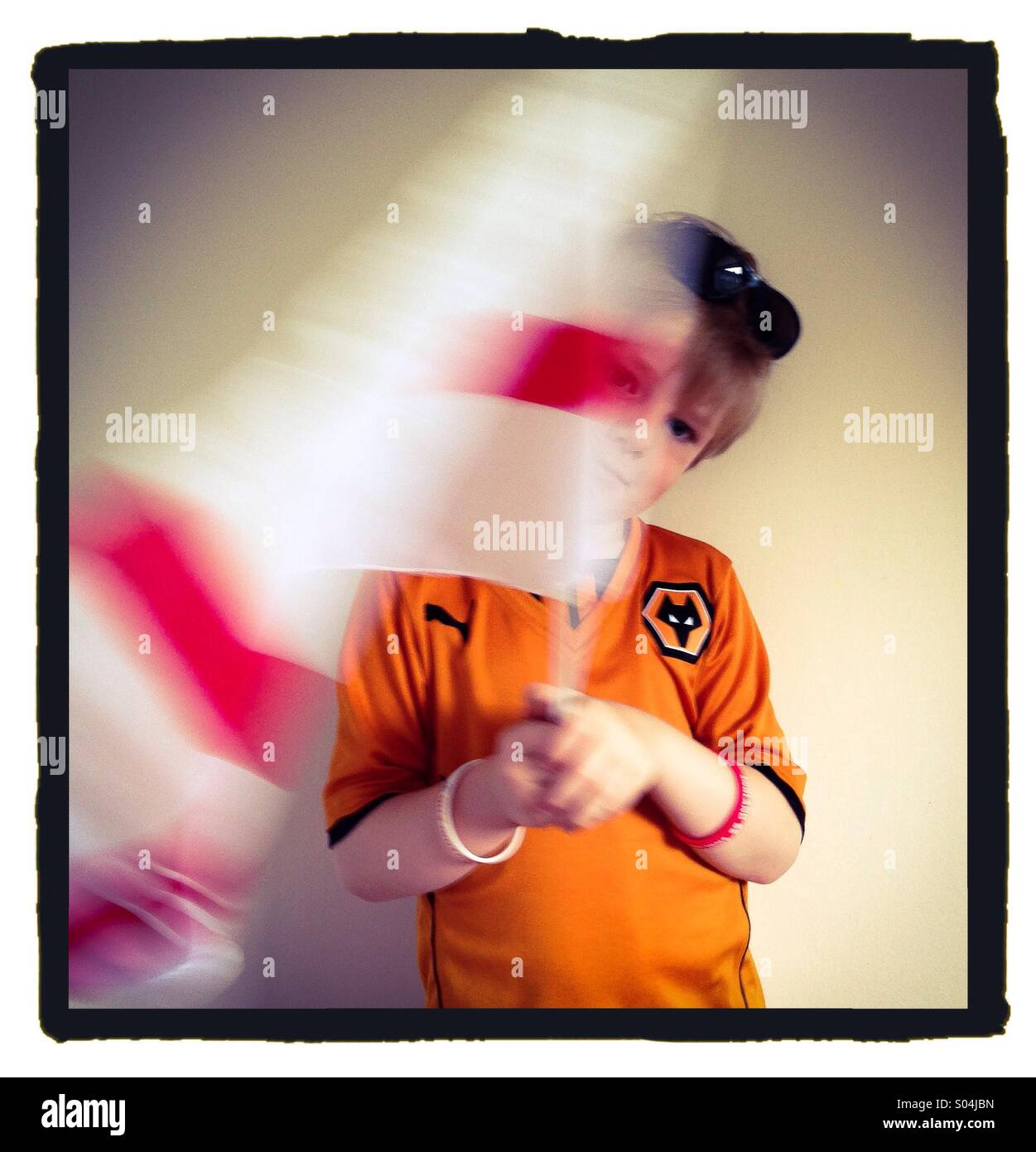 England and Wolves football. Boy waving flag. - Stock Image