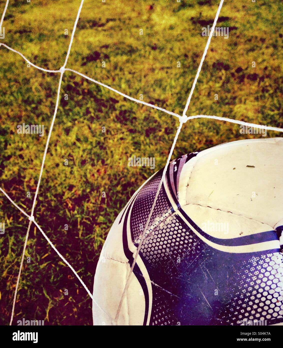 Football in net - Stock Image