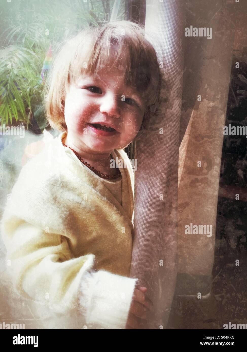 Toddler girl looking at camera happy - Stock Image