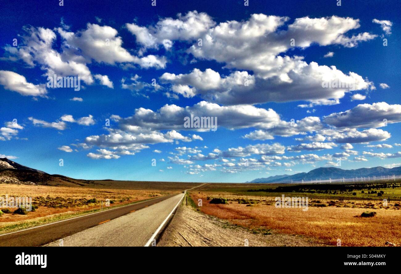 Wide open spaces with road running through it - Stock Image