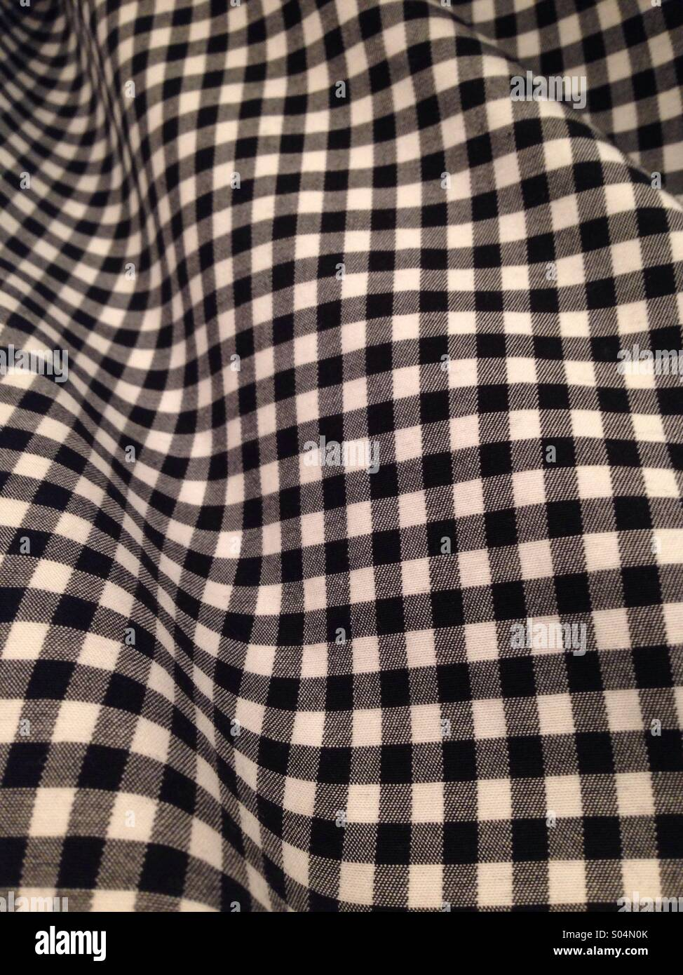 Warped checked fabric, b/w - Stock Image