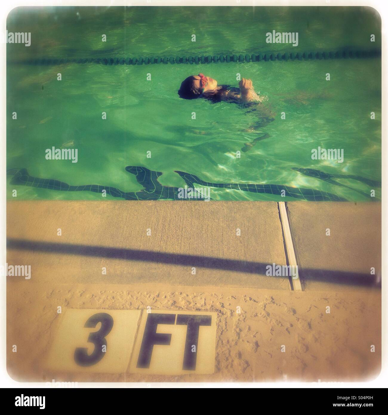 Little practicing how to swim - Stock Image
