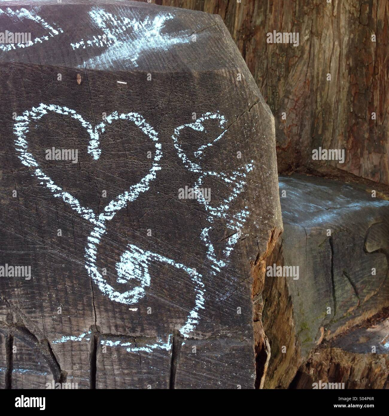 Heart chalk drawing on redwood - Stock Image