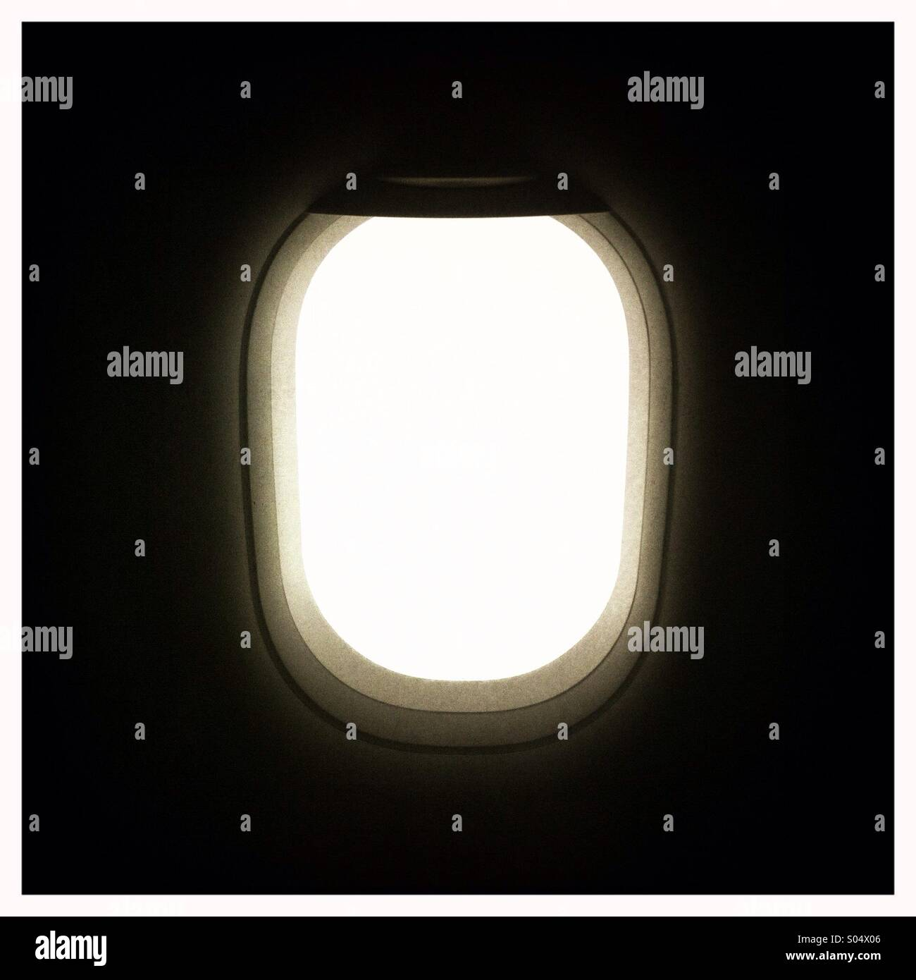 The interior view of an airplane passenger window - Stock Image