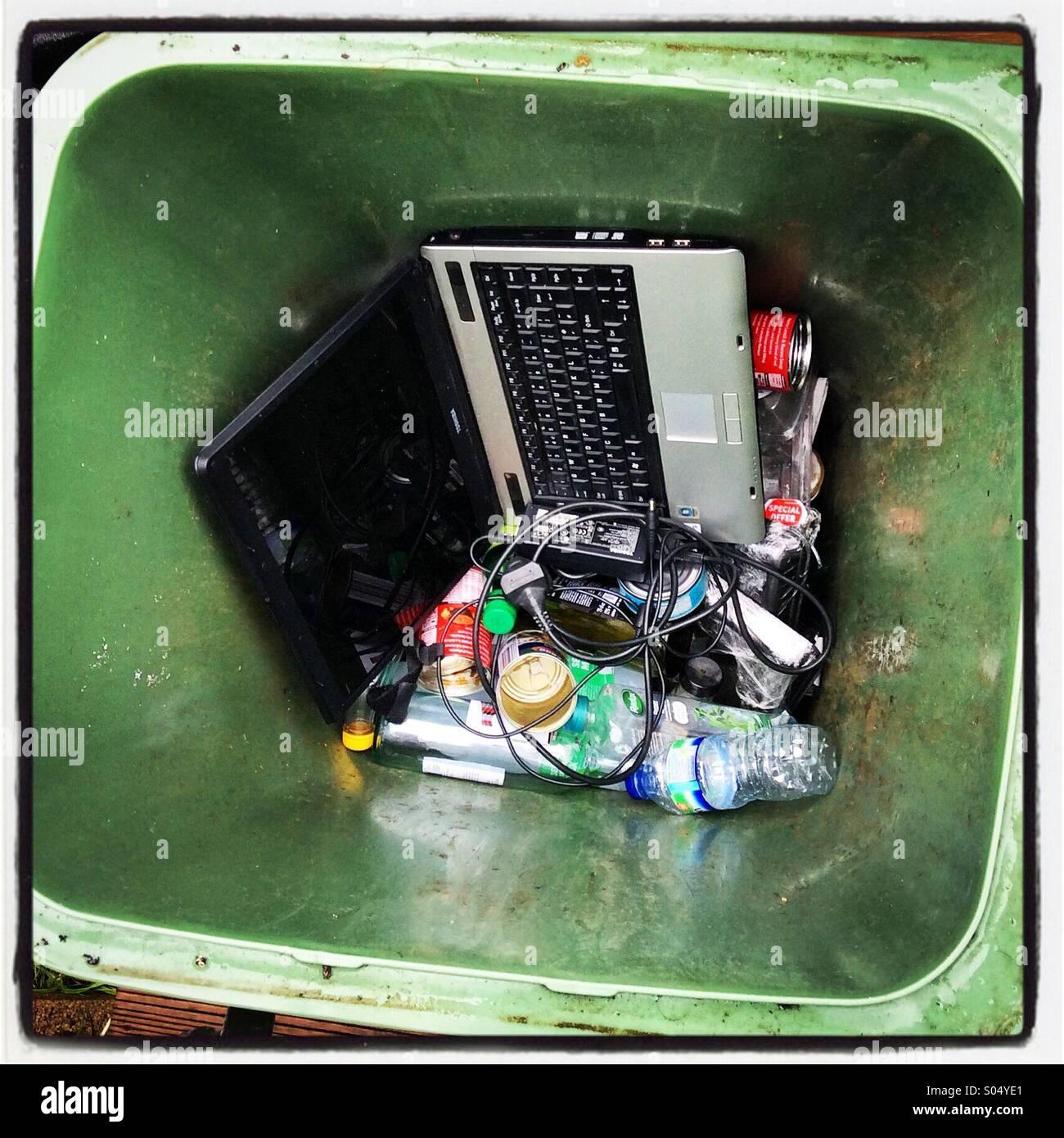 Obsolete laptop in the rubbish bin - Stock Image