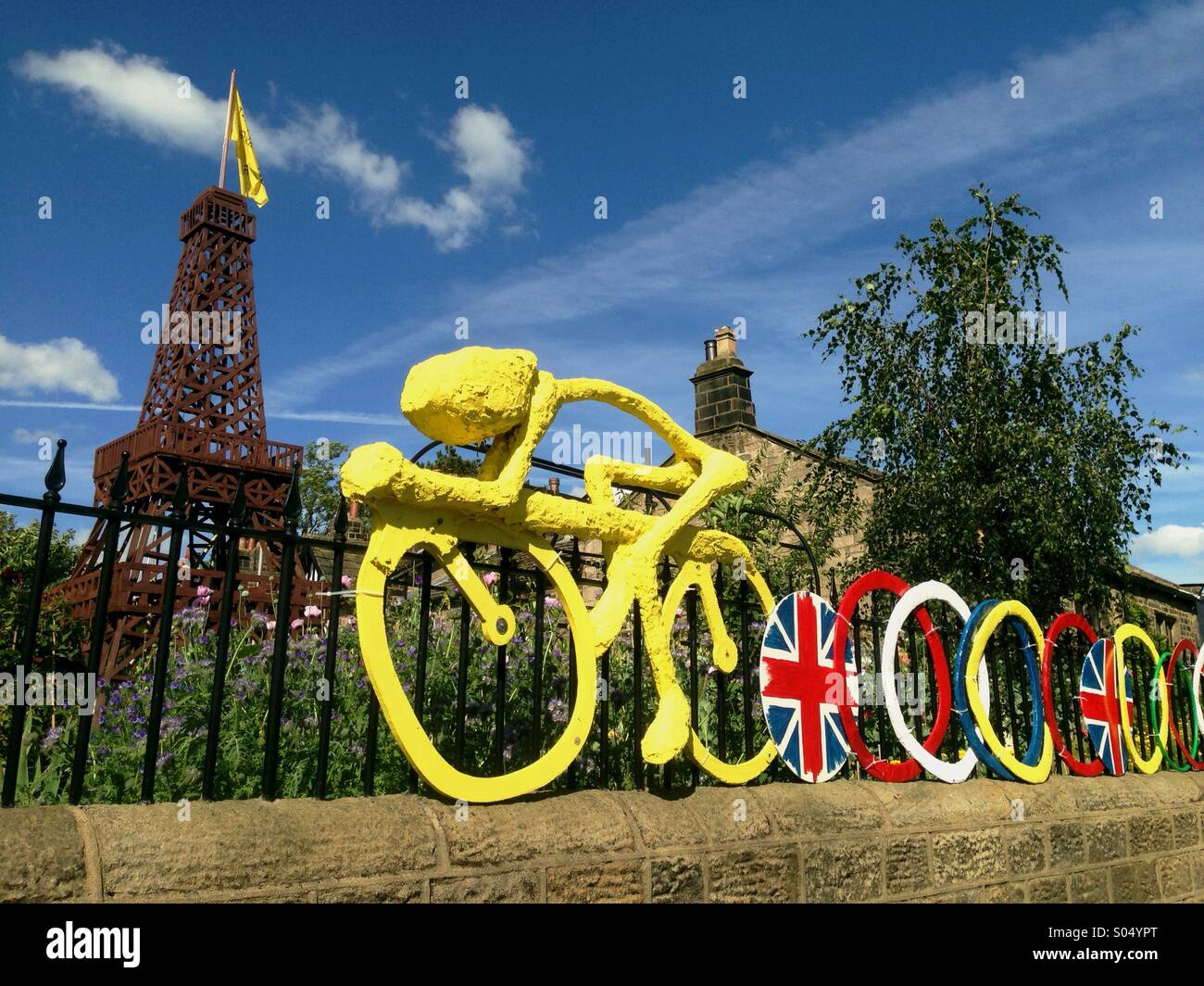 Eiffel Tower and Yellow Bicycle made to celebrate the Tour de France in Burley-in-Wharfdale, Yorkshire by the Guiding Stock Photo