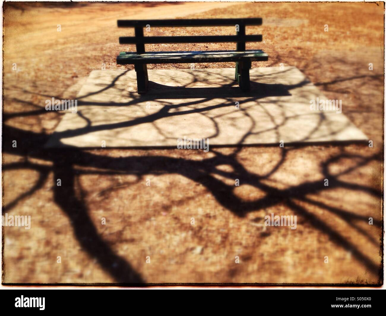 Bench in a public park. - Stock Image