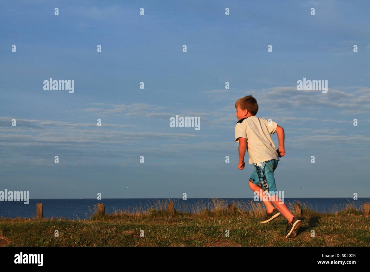 Running along the sea front - Stock Image