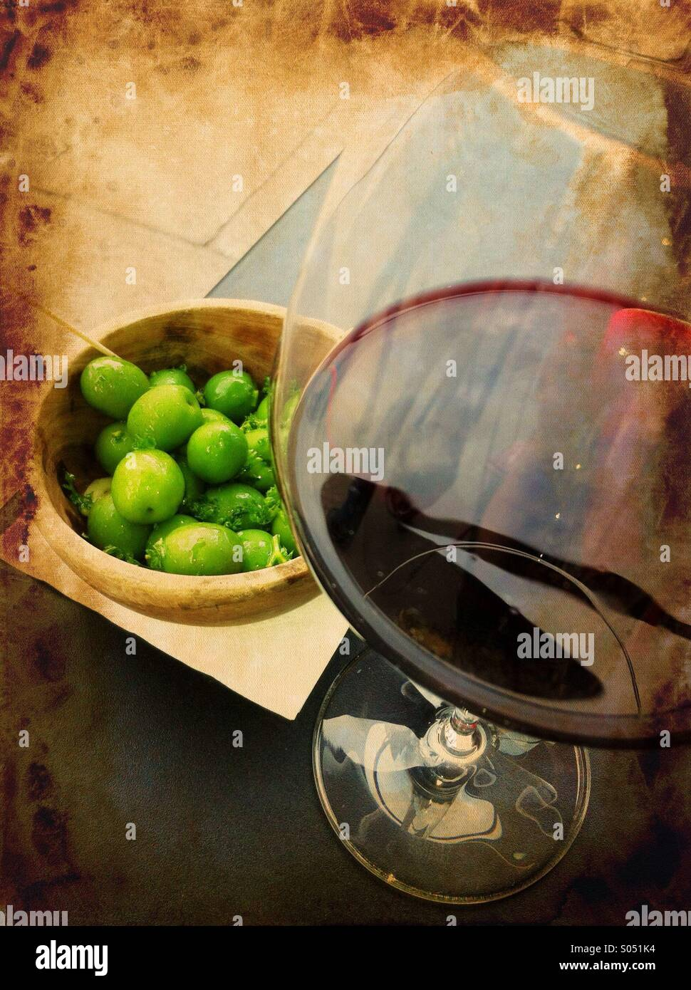 Nostalgia with glass of red wine and fresh green olives in a wine bar, Portobello Road, London - Stock Image