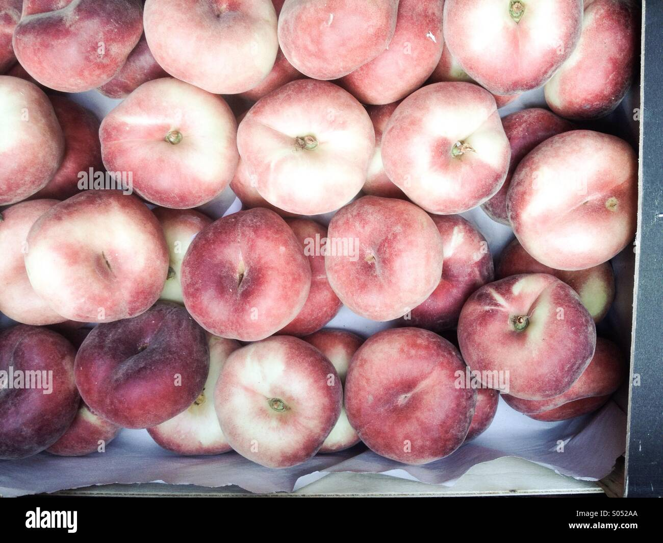 Belly button peaches at he market - Stock Image