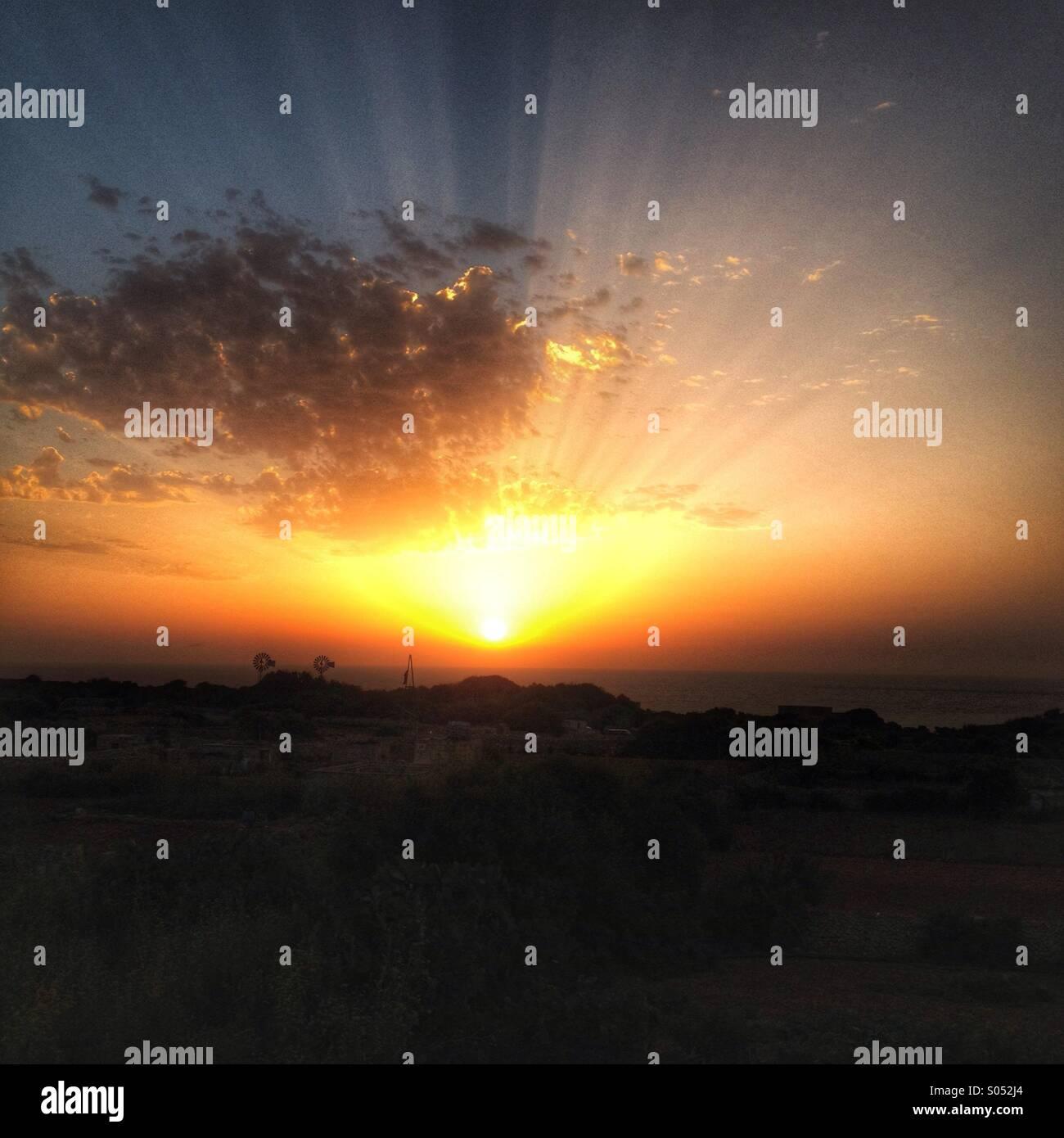 Sunrise looking towards Ramla bay, Gozo - Stock Image
