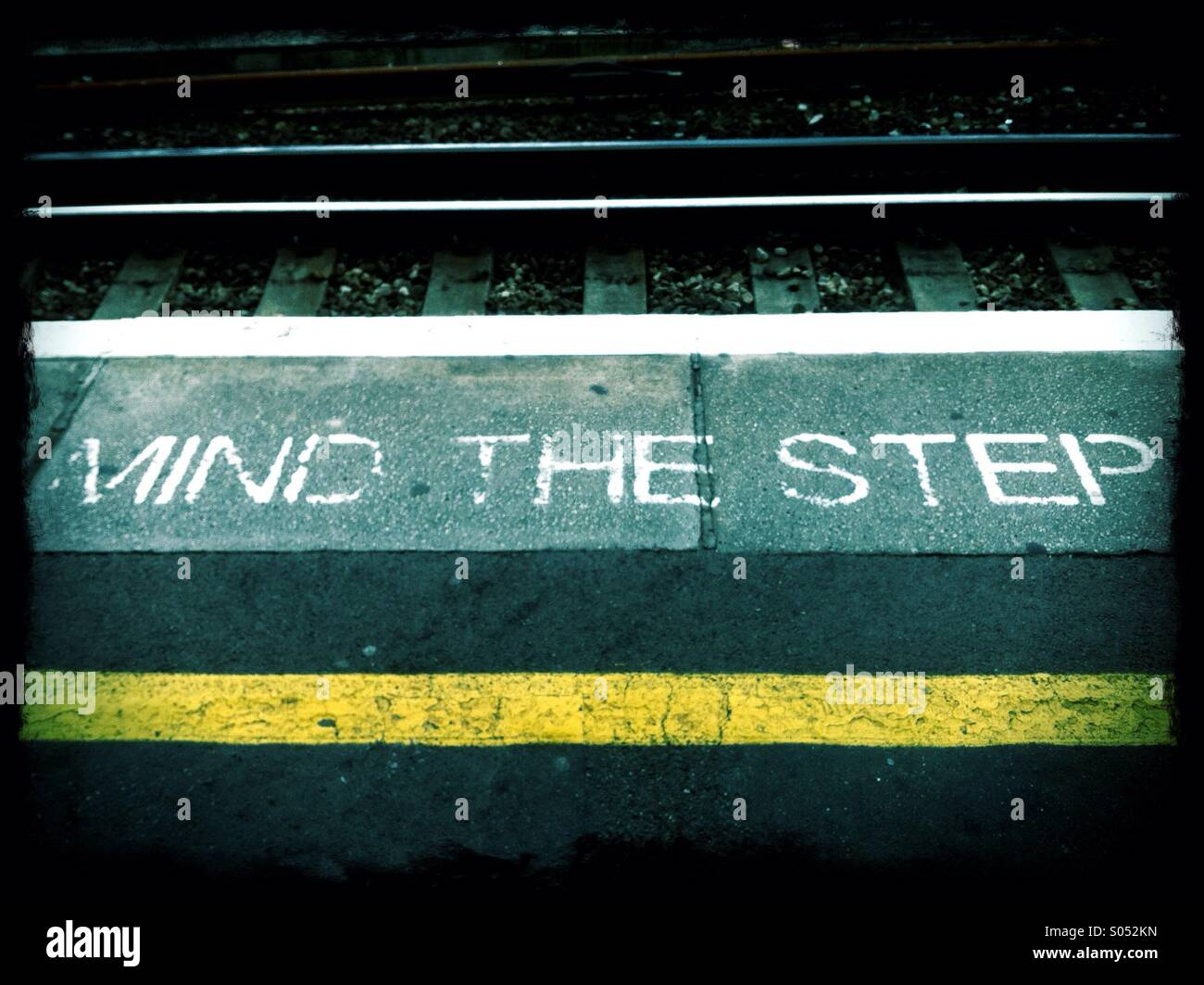 Mind The Step sign on the edge of a platform at a London train station - Stock Image