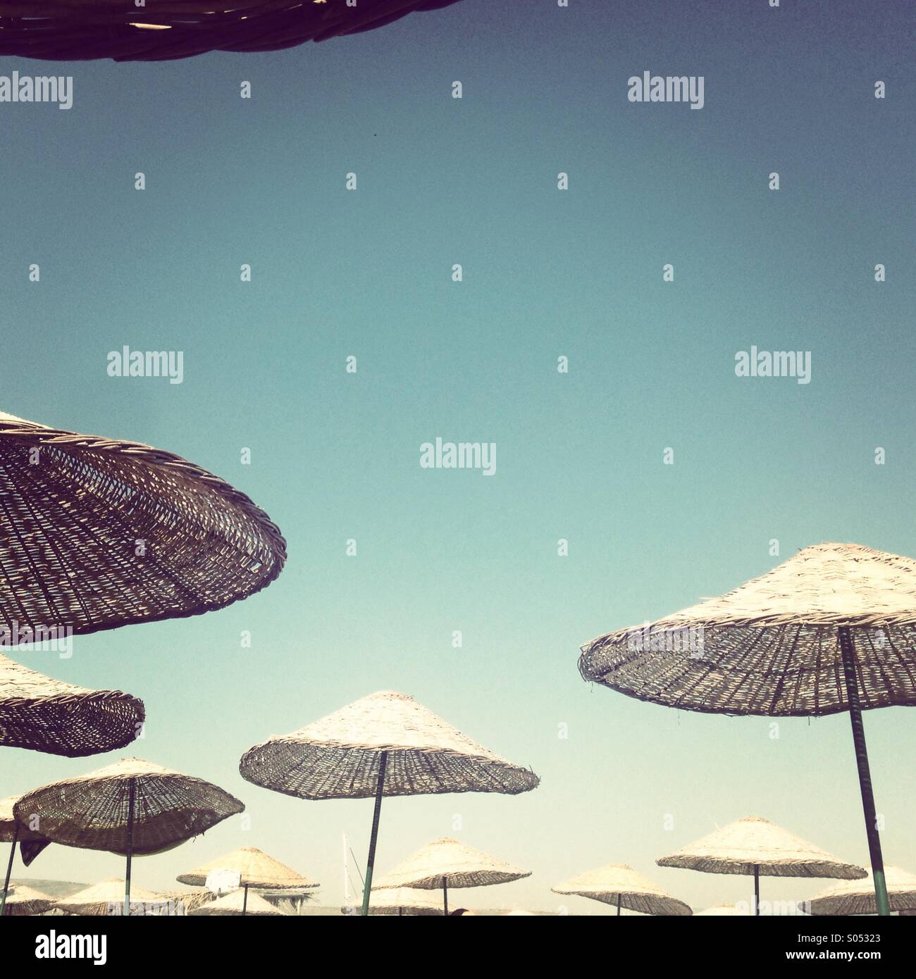 Alacati sun umbrellas - Stock Image