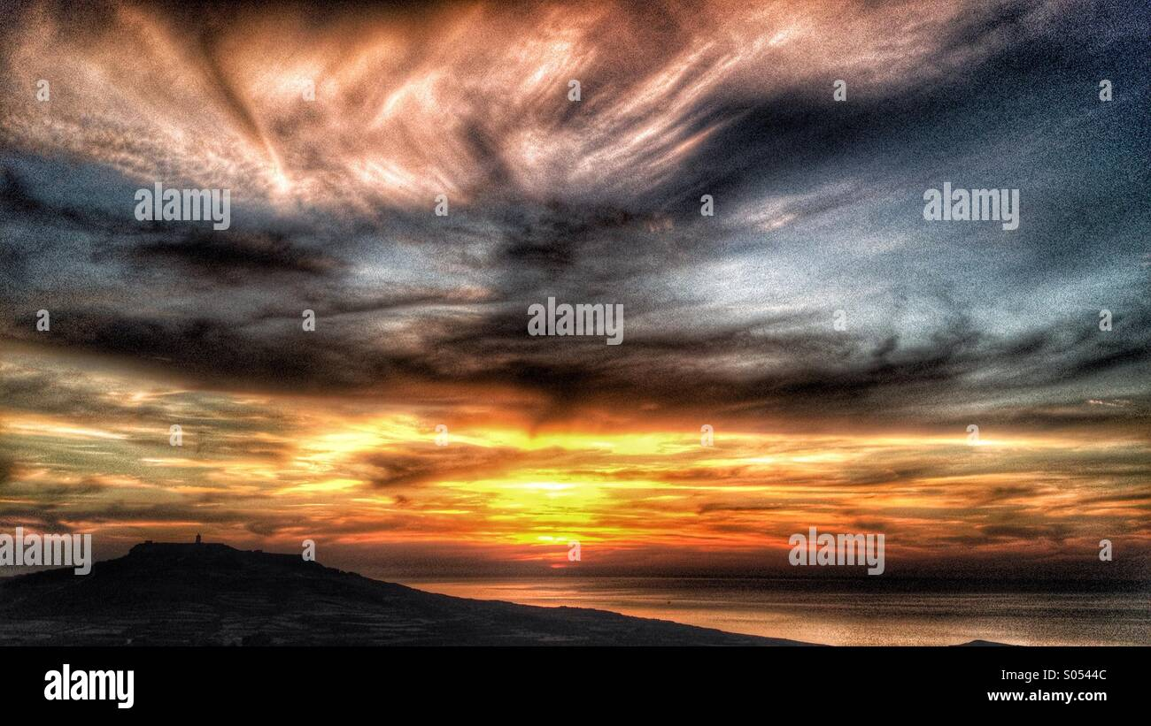 Stormy sky and sunset Gozo - Stock Image