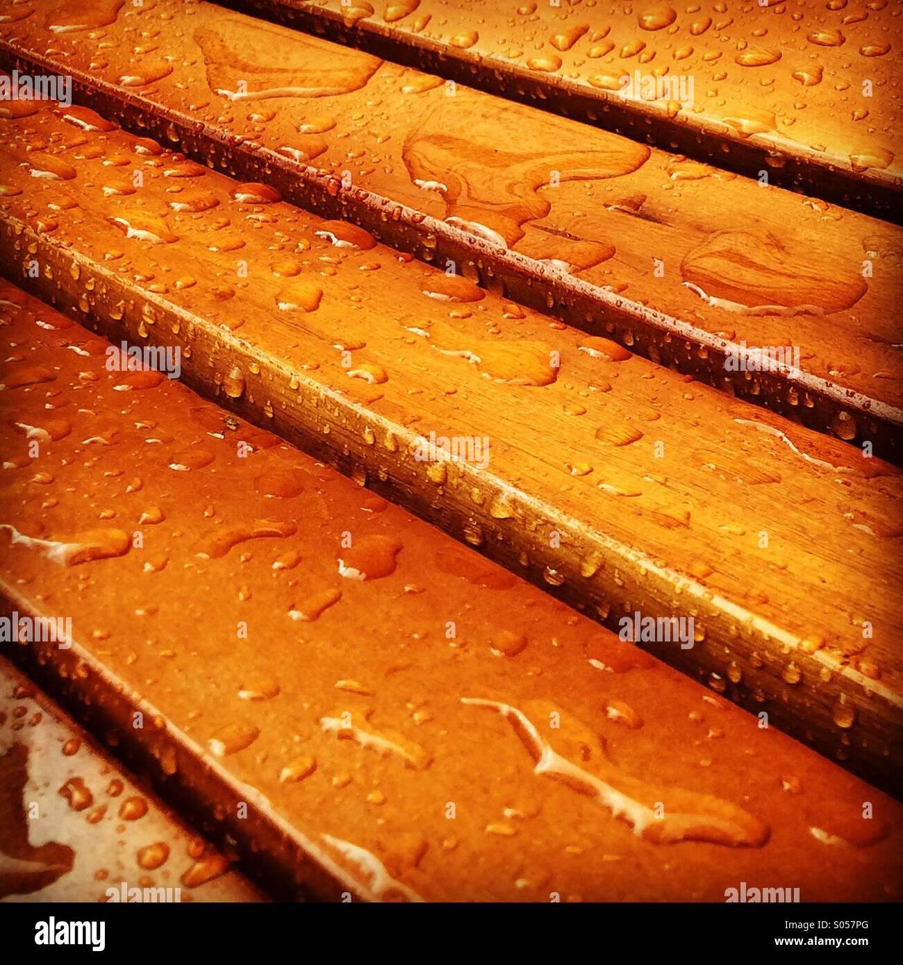 Rain on varnished wood - Stock Image