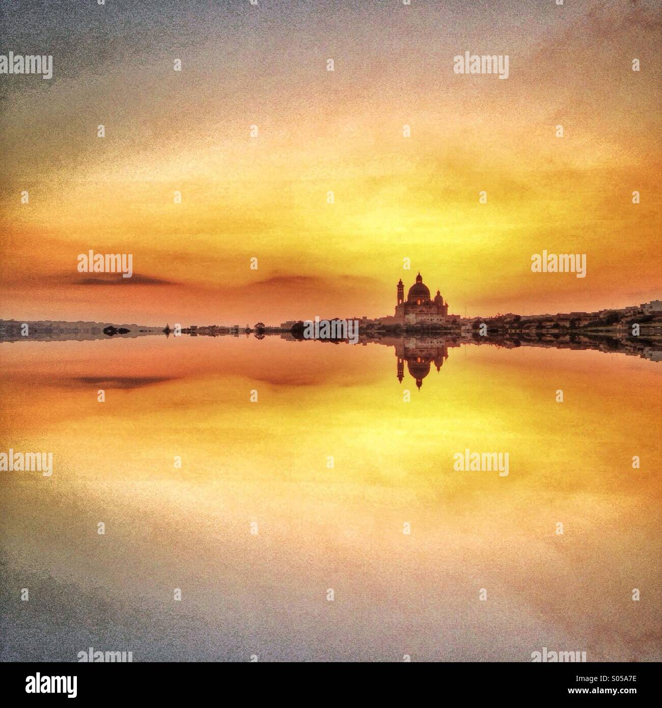 Mirrored church and evening sky - Stock Image