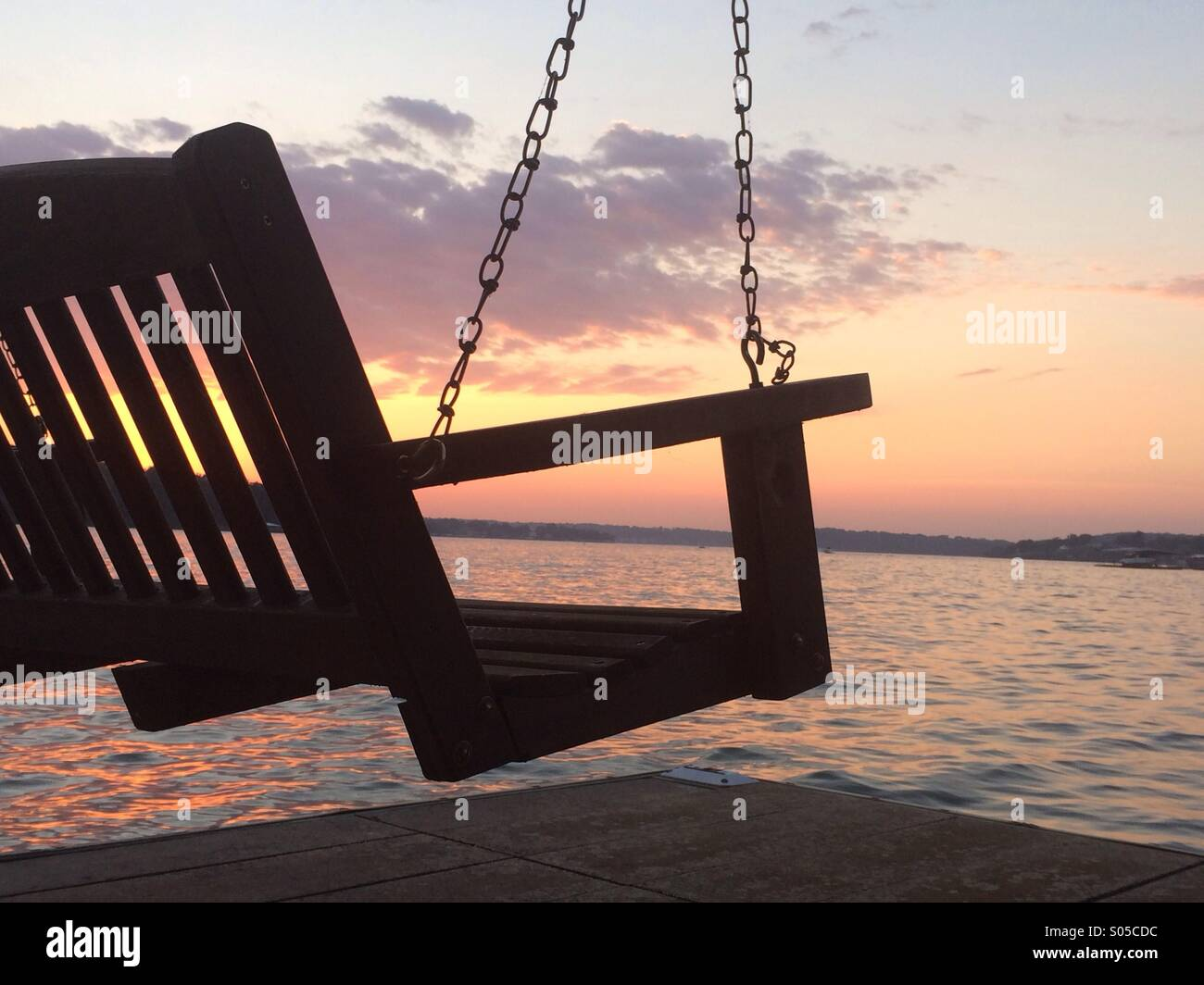 A swinging bentch with sun set