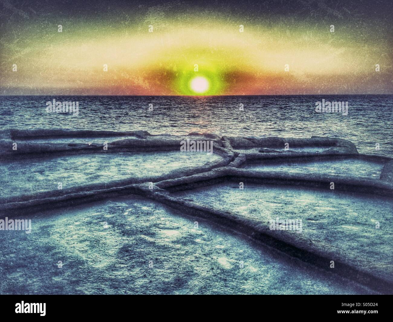 Conceptual rendering of salt pans and seascape at dawn - Stock Image