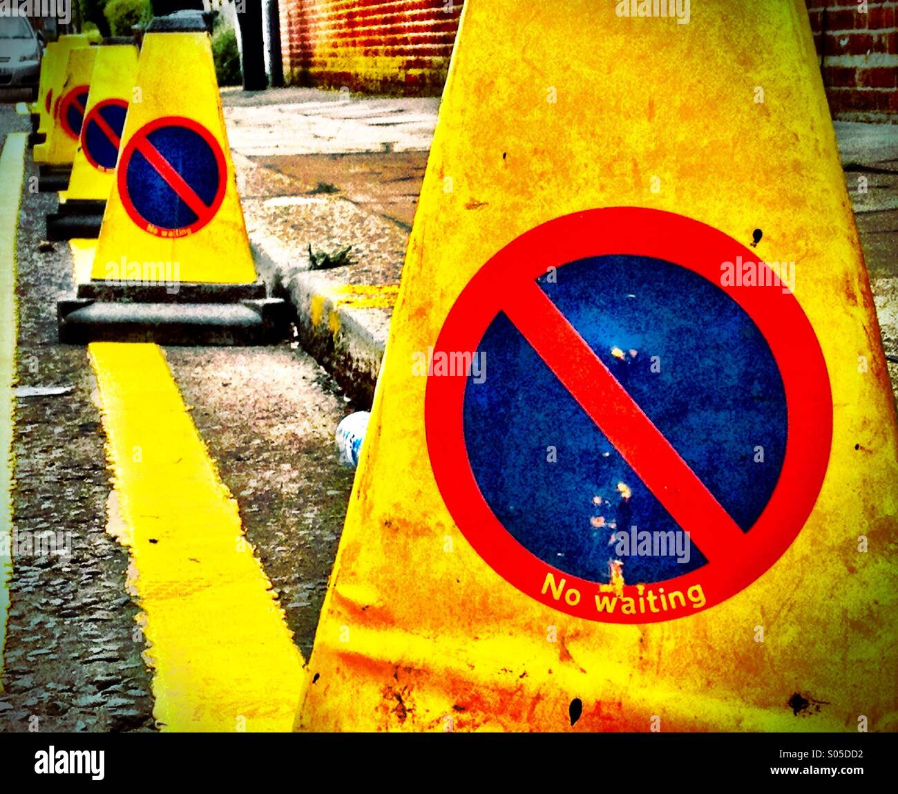Line of No Parking traffic cones along. Street in London - Stock Image