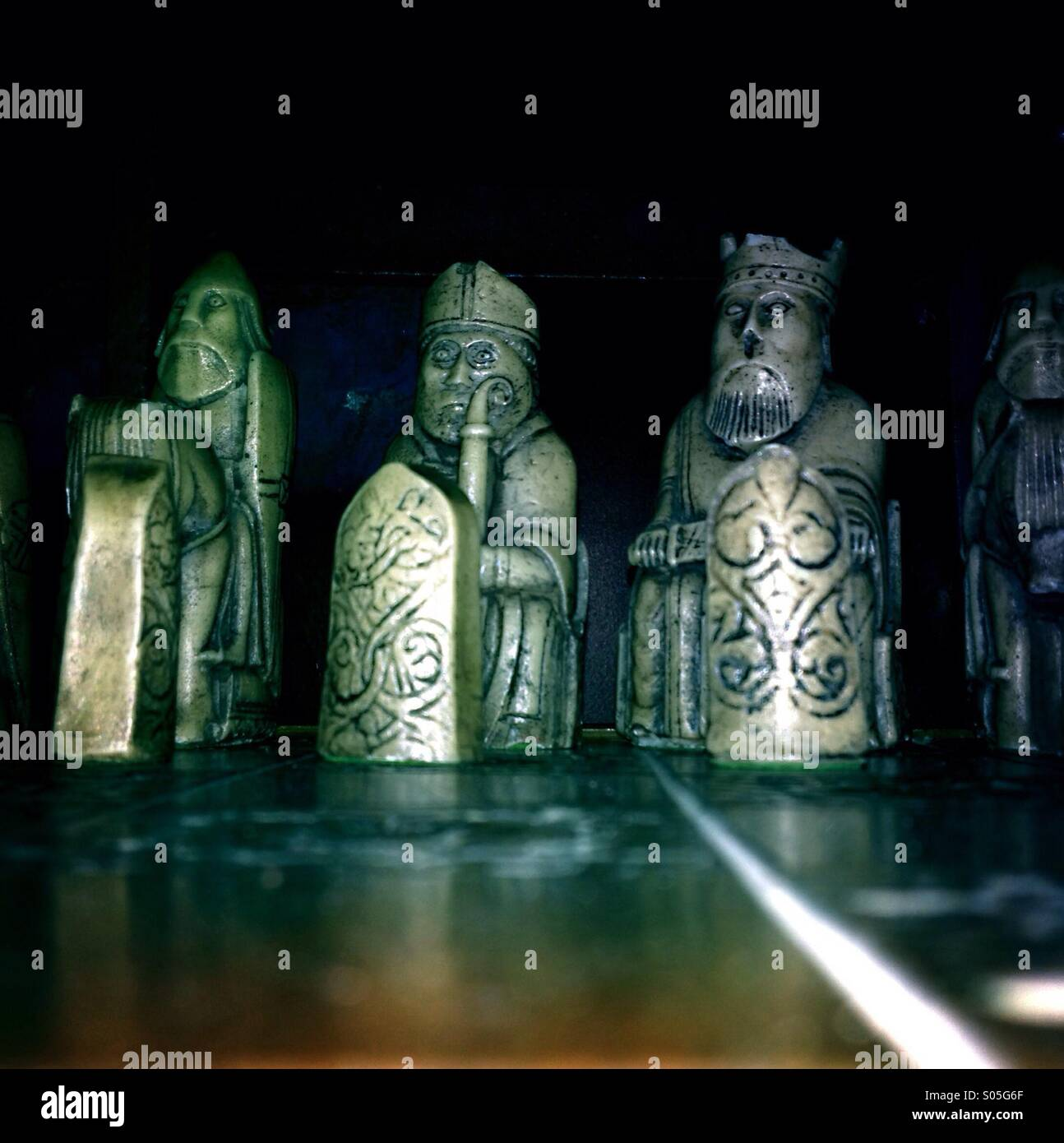 Warrior chess pieces, looking stern angry scowling aggressive. - Stock Image