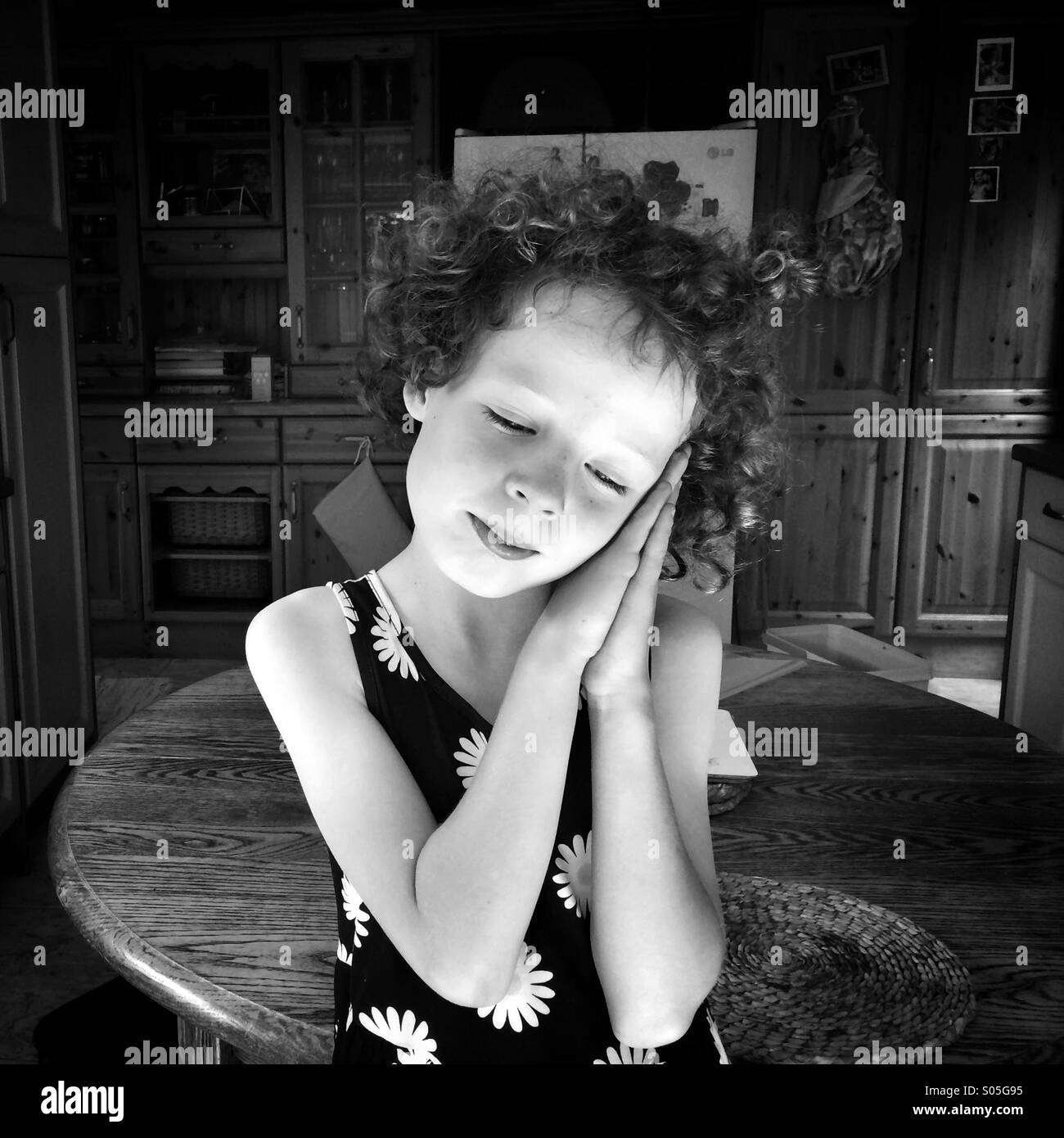 Girl in sleeping pose. - Stock Image