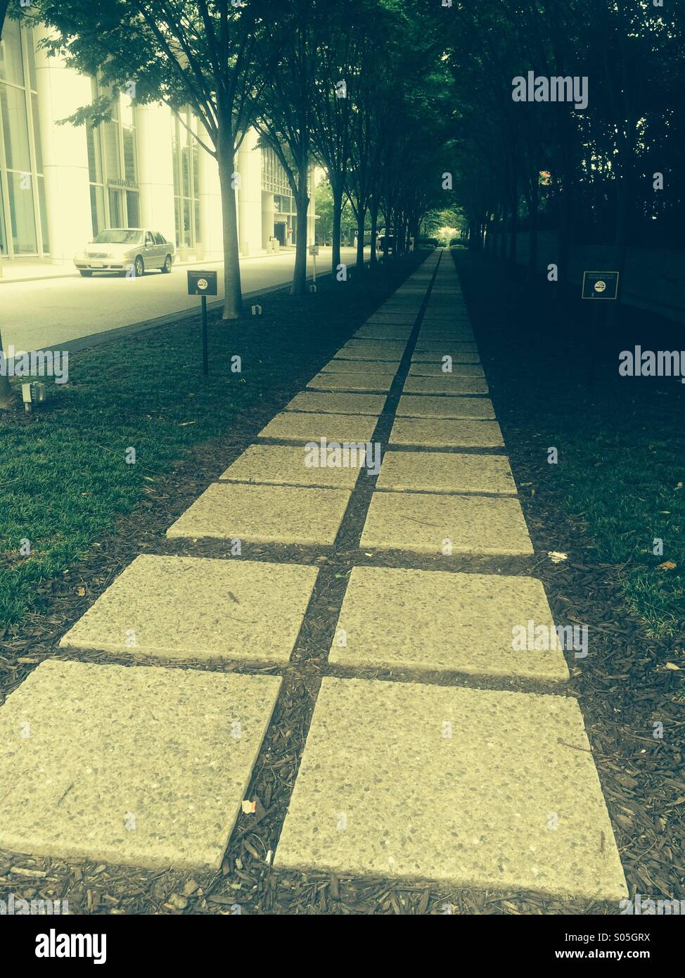 Pathway off Peachtree a Street in Midtown Atlanta, Georgia. - Stock Image