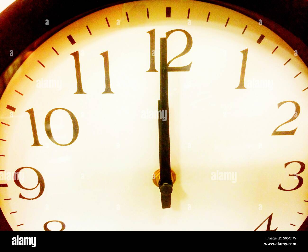 Hands of a clock at twelve o'clock. - Stock Image