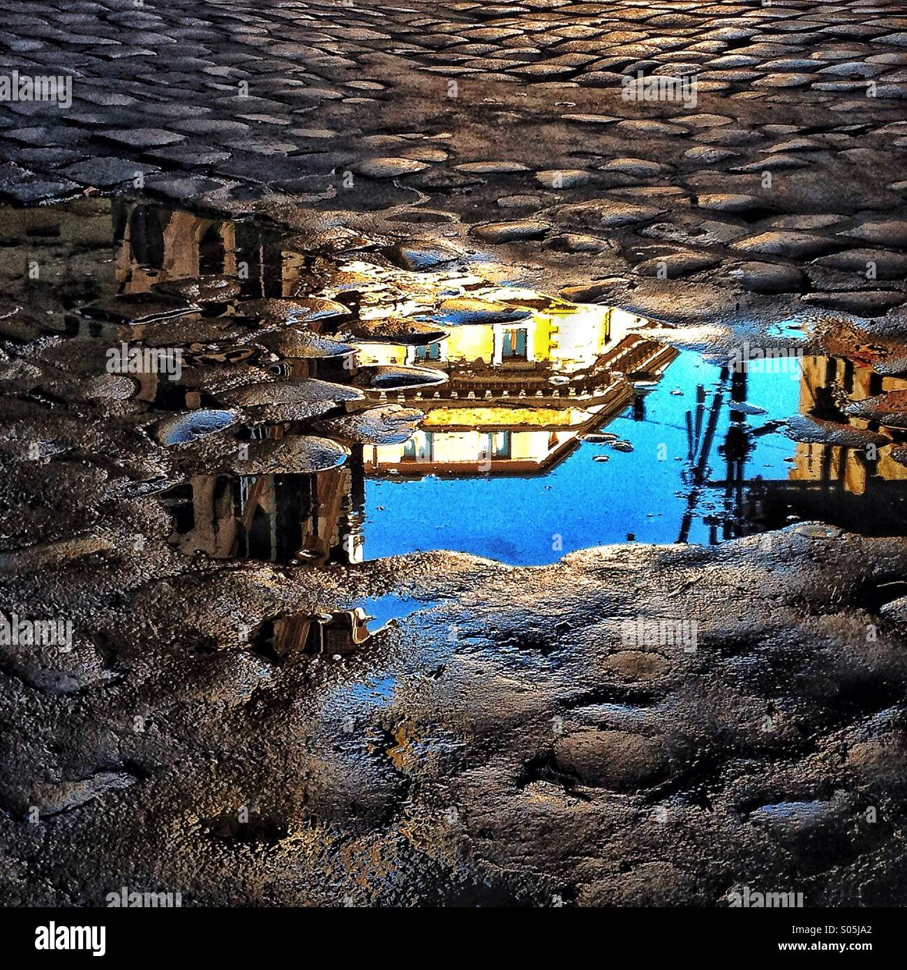 Puddle reflection in Rome Italy - Stock Image