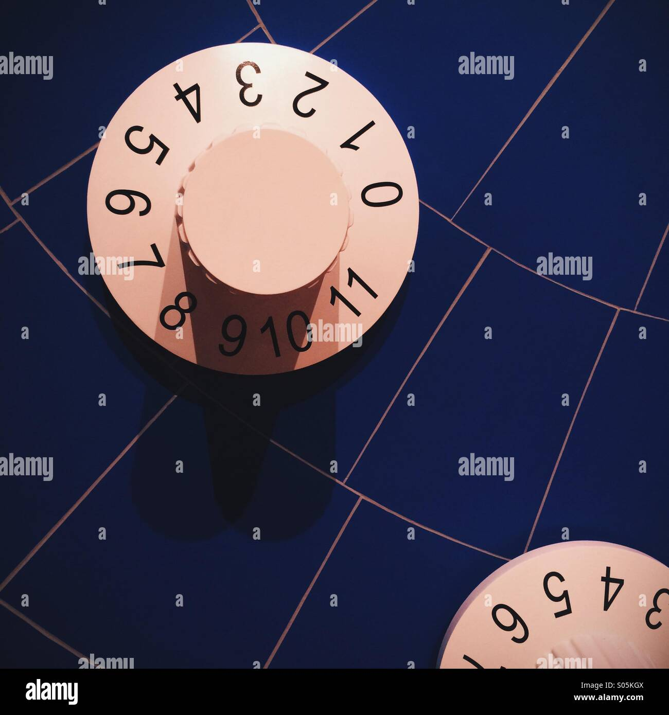 Large volume dials on a blue background - Stock Image