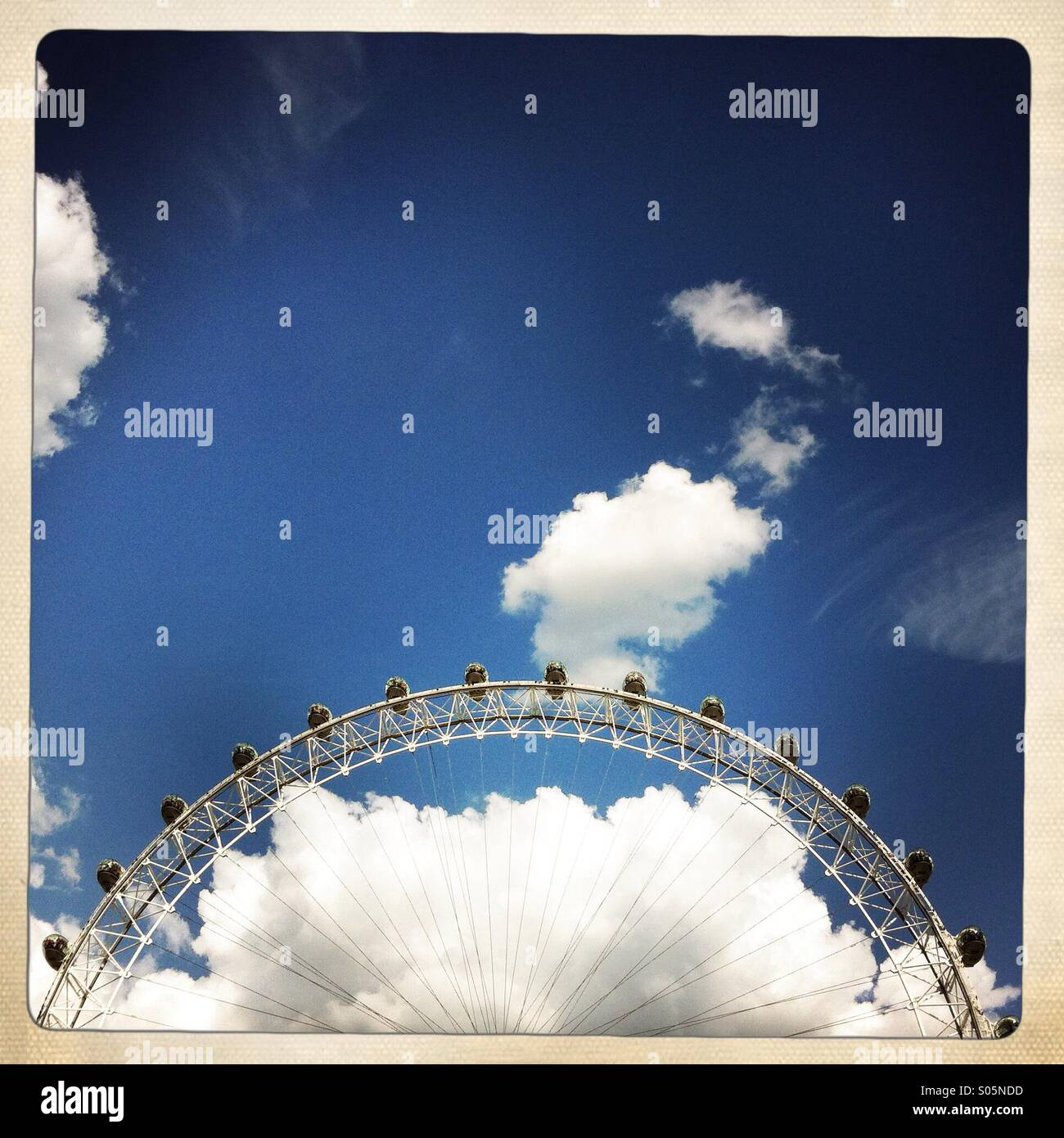 The London eye and clouds. London England UK. - Stock Image