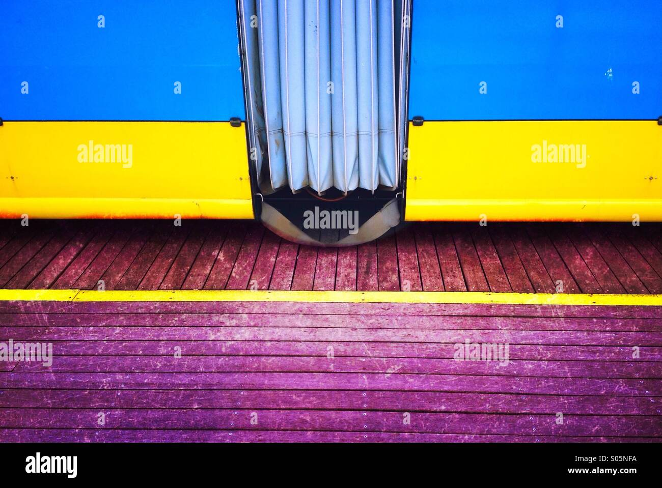 Detail of two tram coaches and yellow warning line - Stock Image