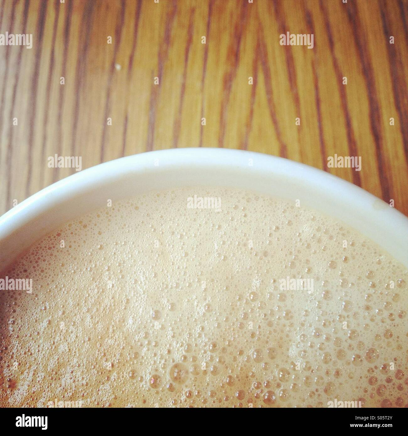 Cup of cappuccino coffee drink detail - Stock Image