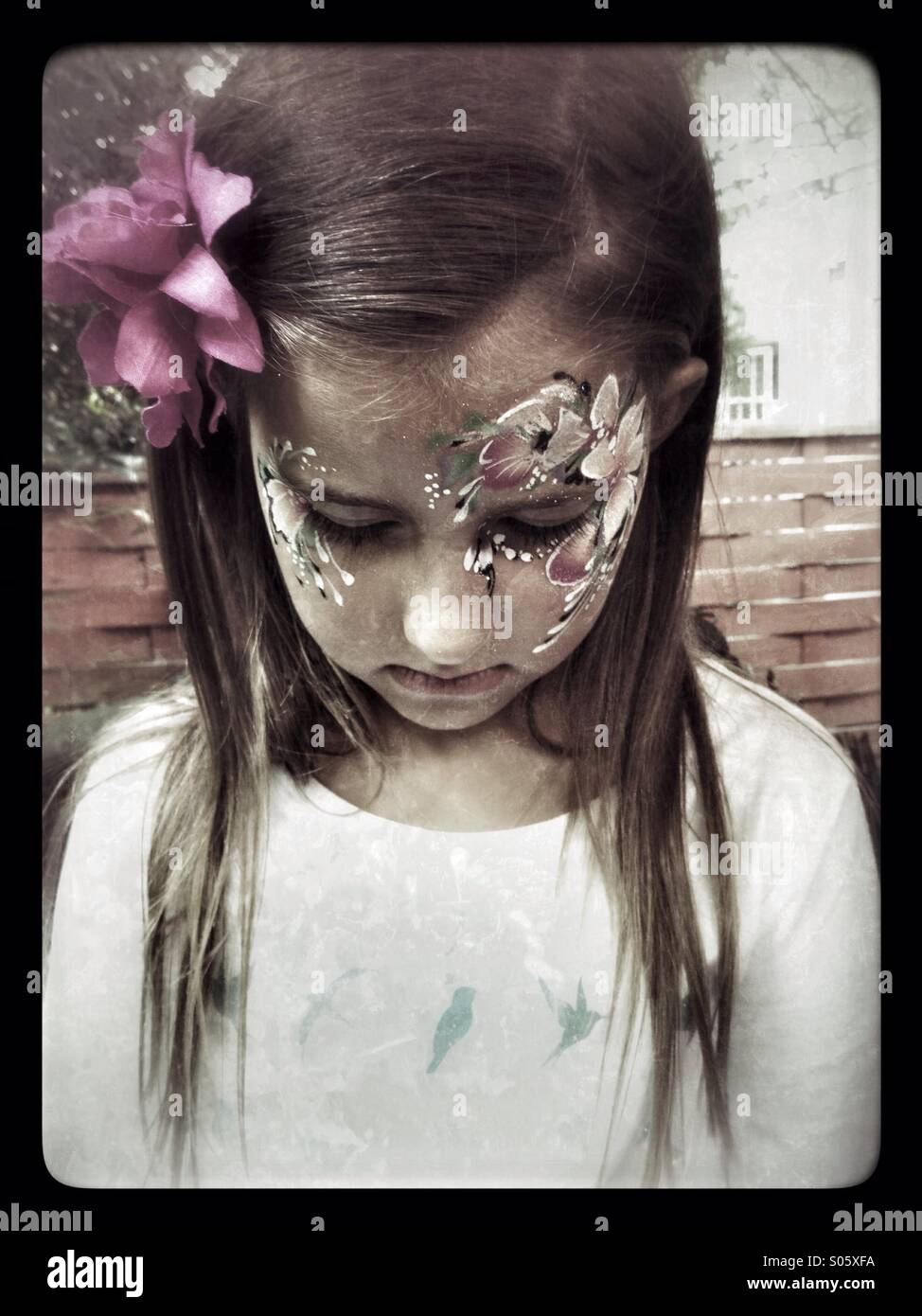 Sad girl with painted face. - Stock Image