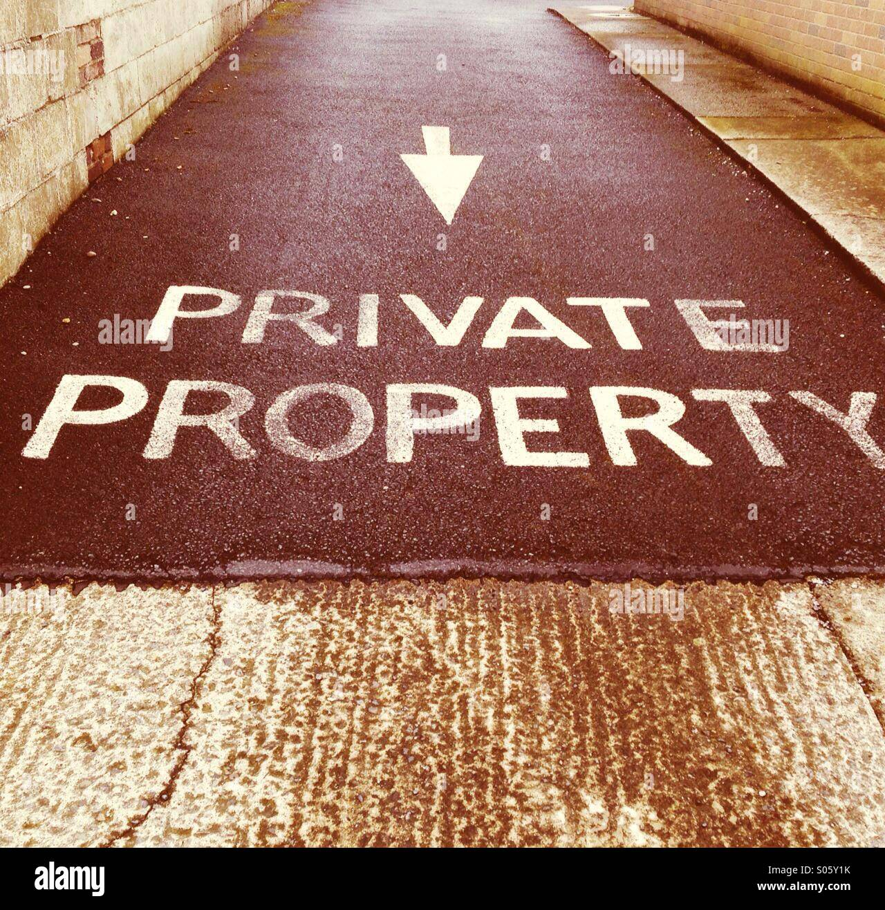 'Private Property' notice written on a driveway - Stock Image