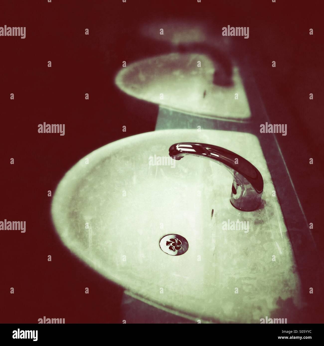 Grunge image of washbasins - Stock Image