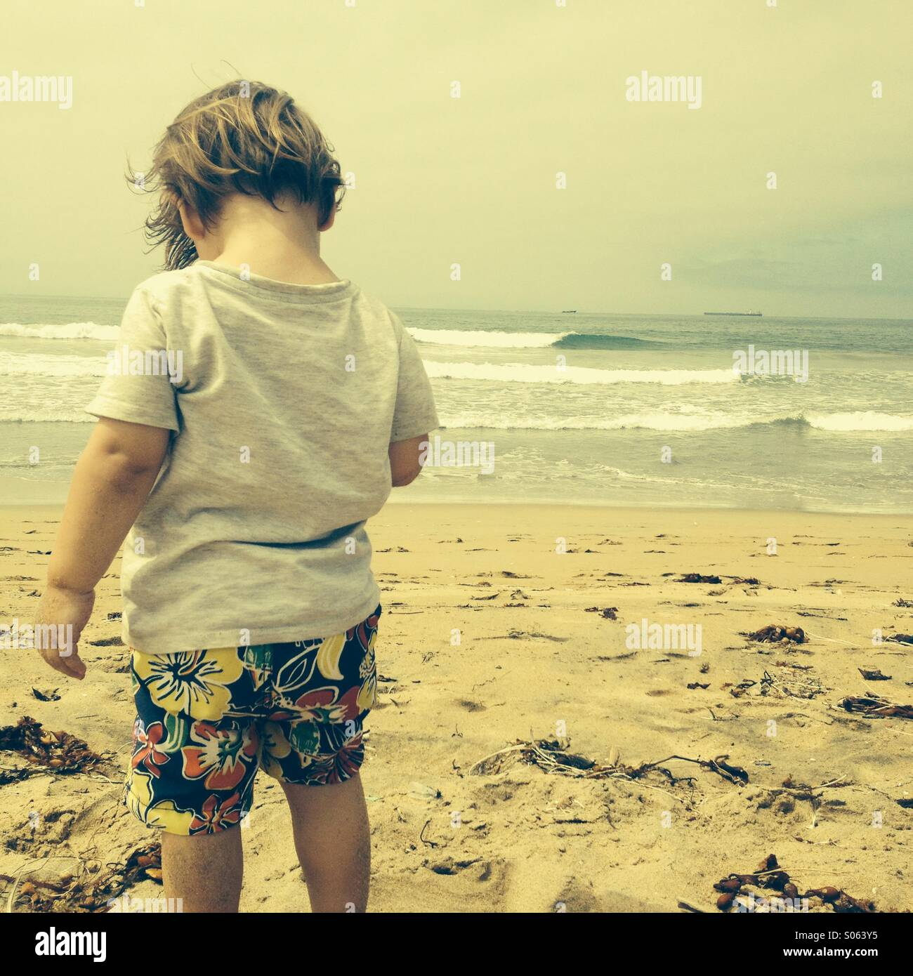 Little boy at the beach. - Stock Image