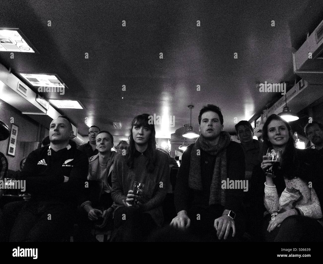 Watching a rugby match in a bar - Stock Image